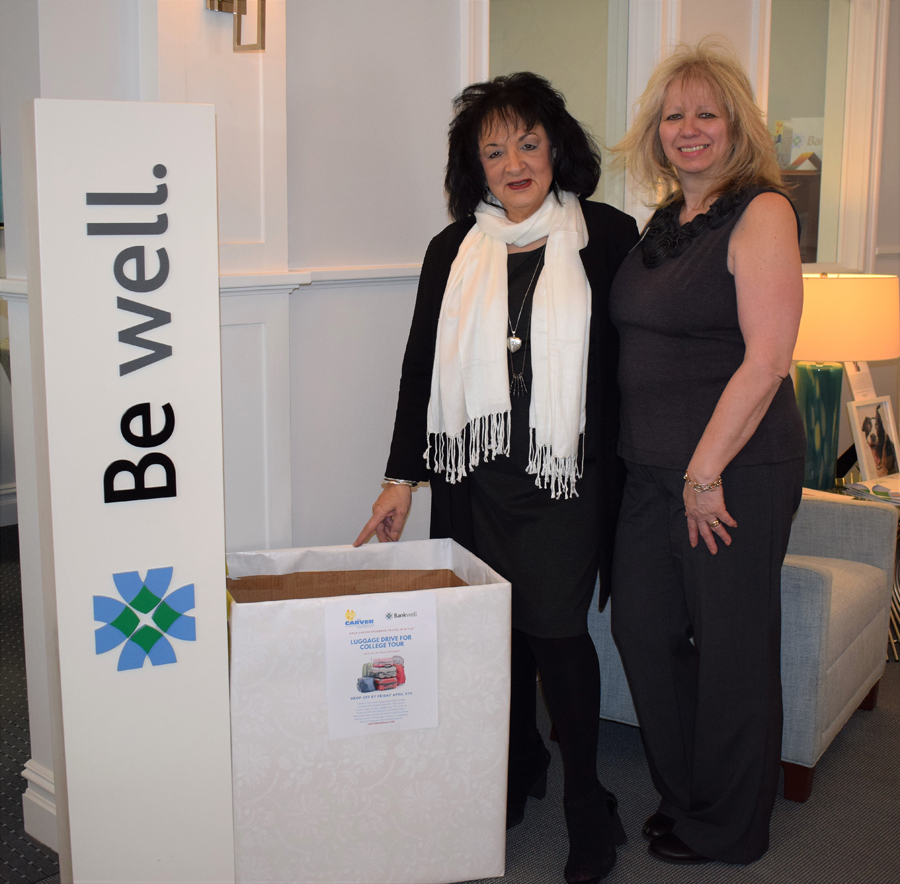 Bankwell in New Canaan Branch Manager, Flo Carbone and Universal Banker at Bankwell in New Canaan, Martha Melitsanopoulos with luggage being collected for the Carver Foundation's College Tour.— Contributed photo