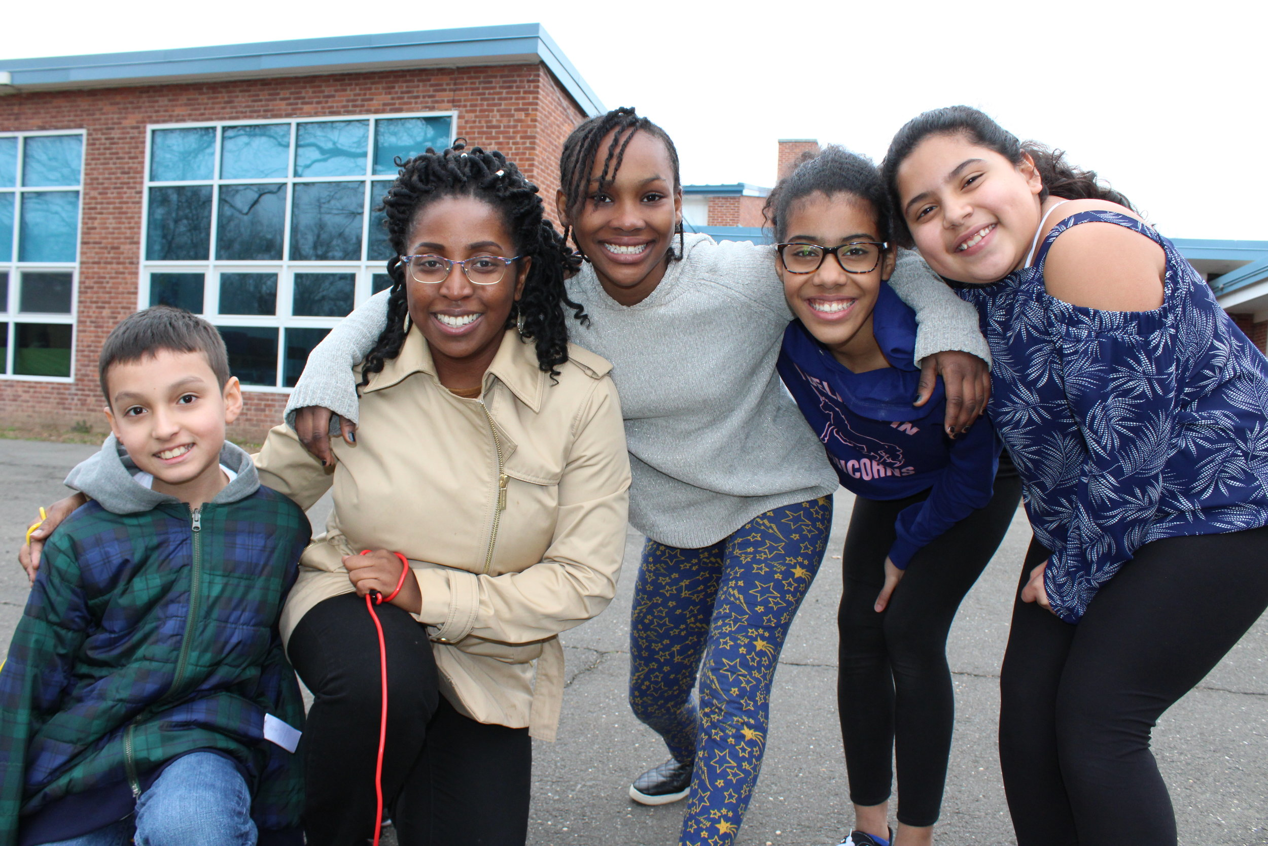 Program Coordinator Latoya Lisle with some of her 5th grade after school students playing Double Dutch!