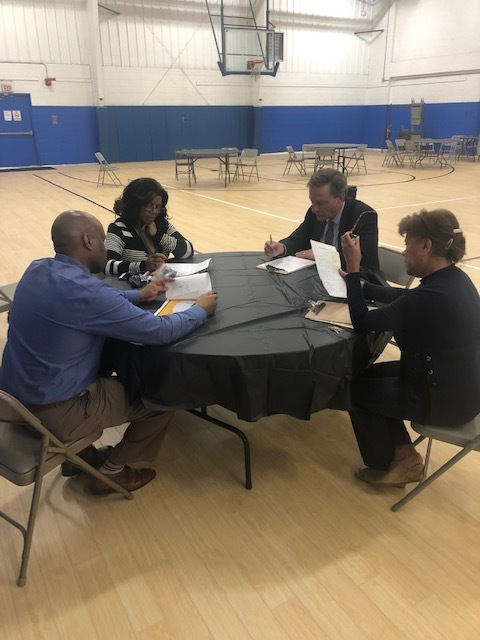 The panel of judges discussing the merits of each student presentation. L-R: Clinton Hamilton, COO; Jacqueline Roberson, Social Worker; Fred Wilms, Carver board member; ad Elsie Lopez, Executive Administrator