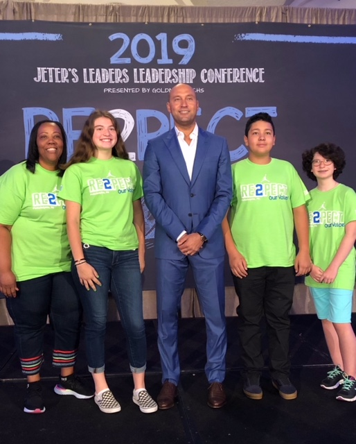 Carver CEO Novelette Peterkin, rising Norwalk 9th graders Chloe Mattus, Sanda Andronic and Alfredo Yepez, with Derek Jeter standing in the middle.