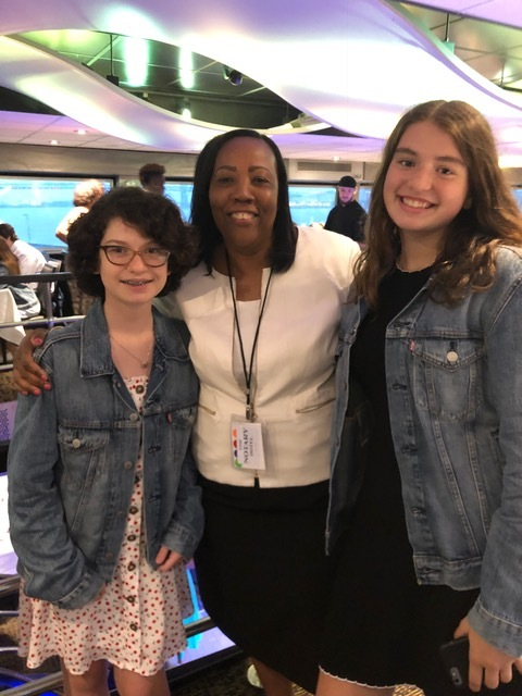 Novelette Peterkin with Norwalk students Chloe Mattus and Sanda Andronic