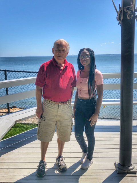Rotary member and longtime Carver volunteer Patrick Steele standing with Carver student and scholarship recipient Rashida Richard at