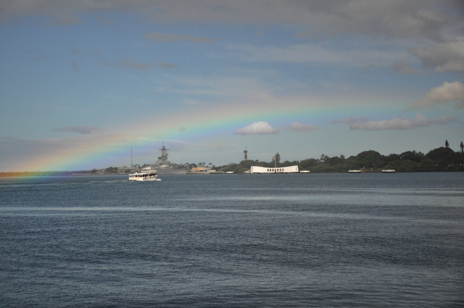 View from Contemplation Circle of Pearl Harbor with the USS  Arizona  memorial and USS  Missouri  in the background.