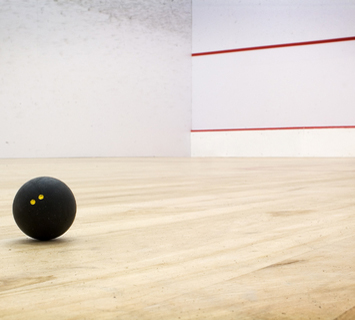 Squash ball (Photo credit:  http://www.thecliftonclub.co.uk/squash-courts.html )