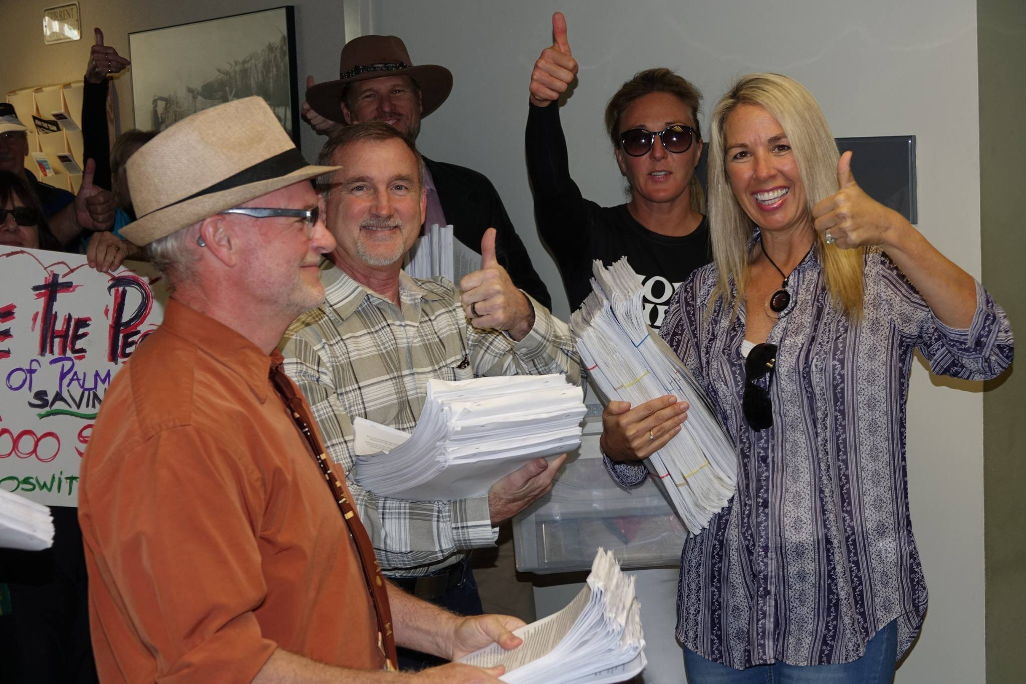 Save Oswit Canyon presents 5000 petition signatures to City Hall to stop development in Oswit.