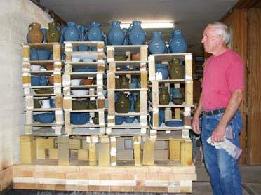 Bobby unloading kiln he has fired.