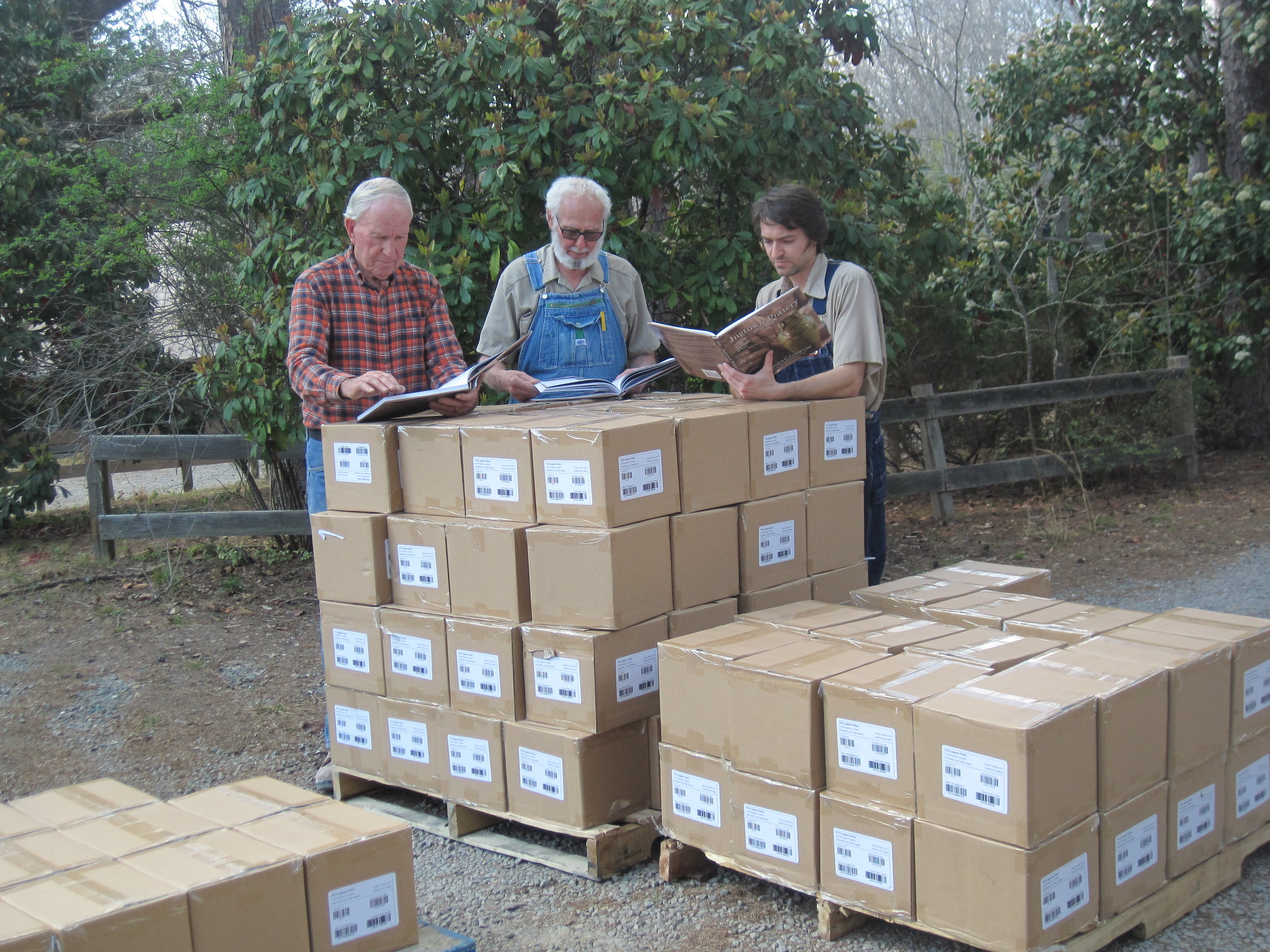Bobby, Vernon and Travis looking at the new books immediately after delivery - they look great!