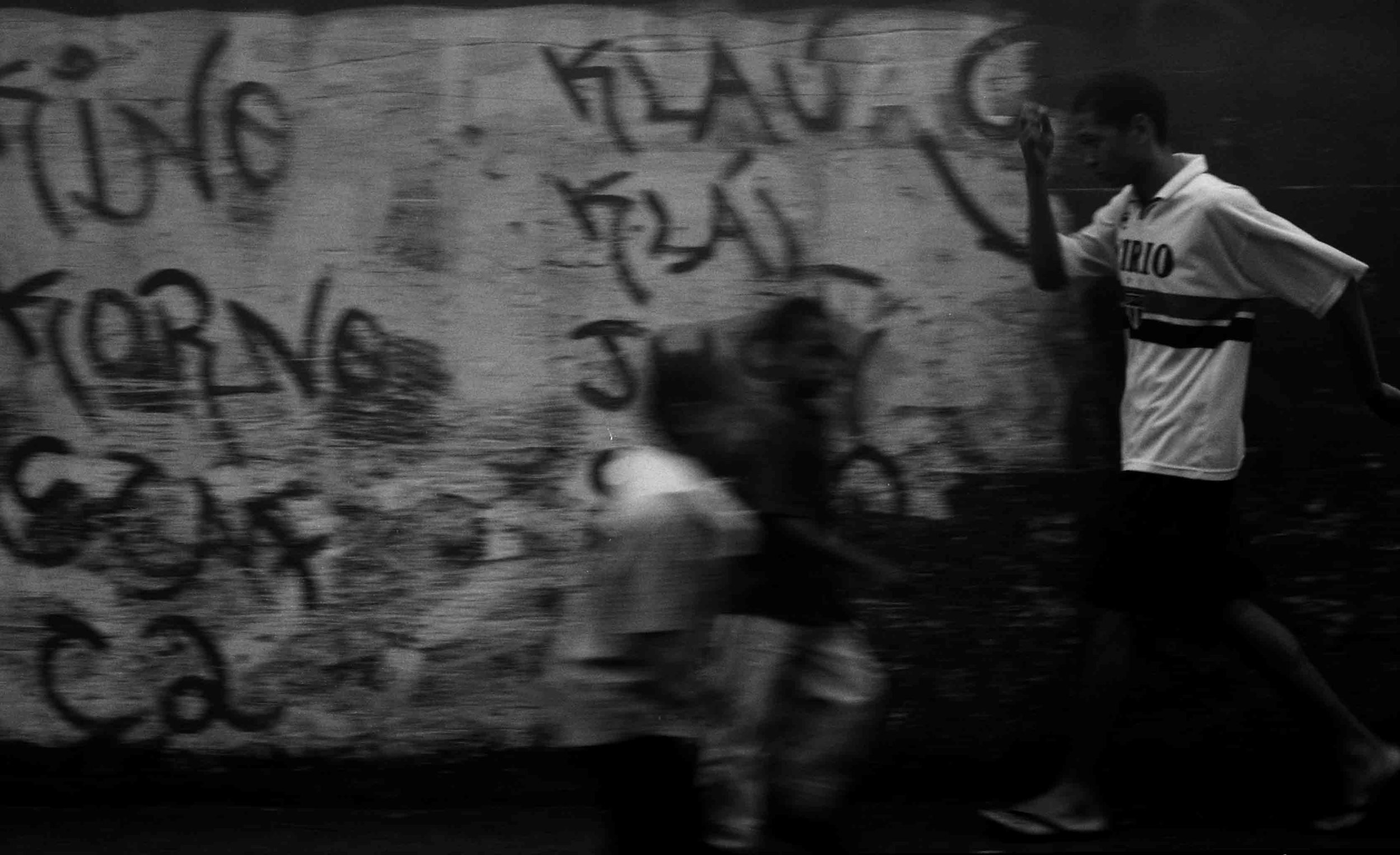 Boy on Street with Graffiti copy.jpg