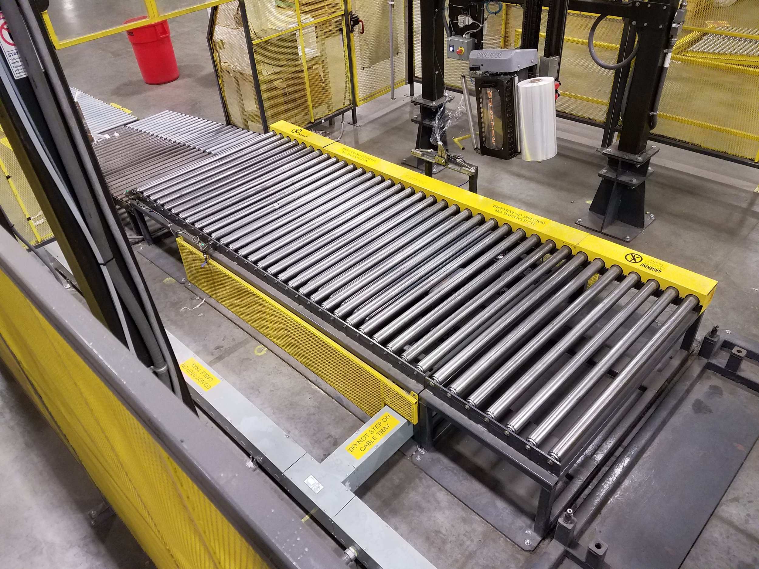 The second wrapper station conveyor