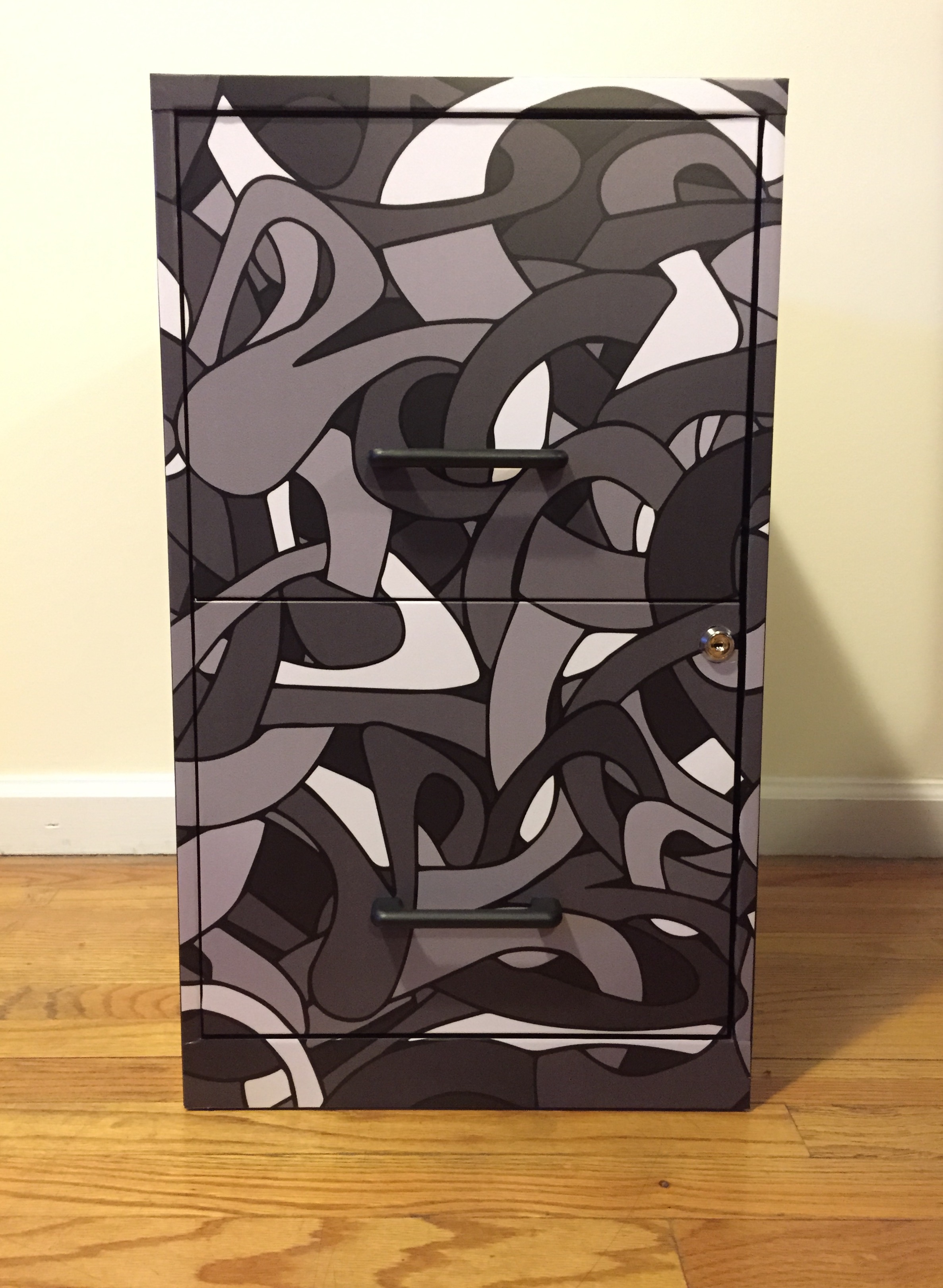 """Filing cabinet with matte laminated vinyl print installed on the front.   14.25"""" x 24.5"""""""