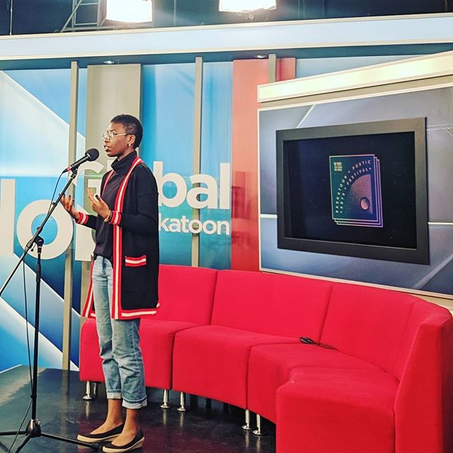 It was a blast being on @global_saskatoon this morning. Just one more sleep until #spaf2019! • • • [ID: Peace standing and reciting a poem on the Global news set, in front of a red couch and the SPAF logo. End of ID.] • • • #yxe #sk #Treaty6Territory #tvset #poetry #morningshow #festivalensemble #peaceakintade #skarts #yxearts
