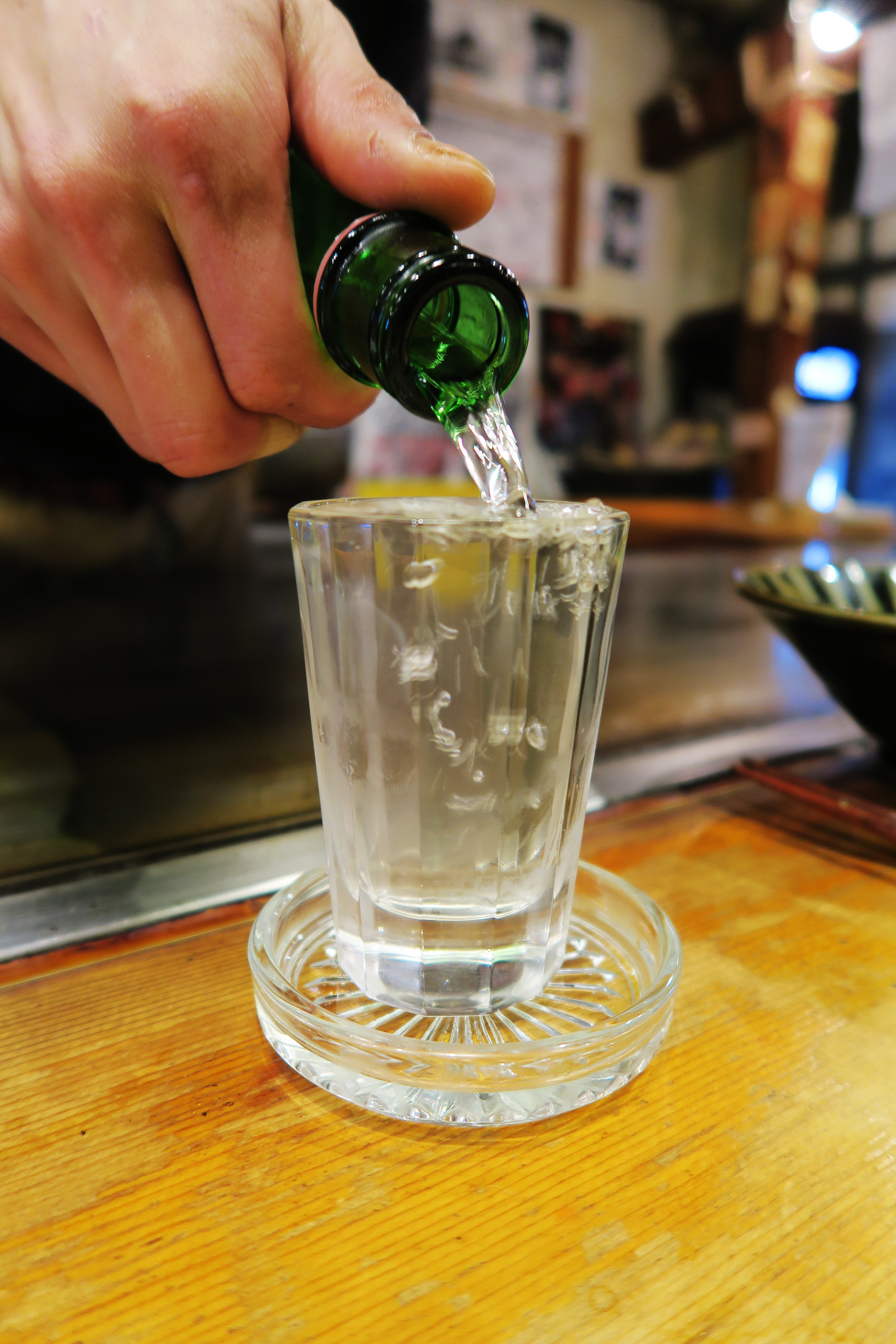 Bakawarai Kichijoji Izakaya overflowing cup of sake