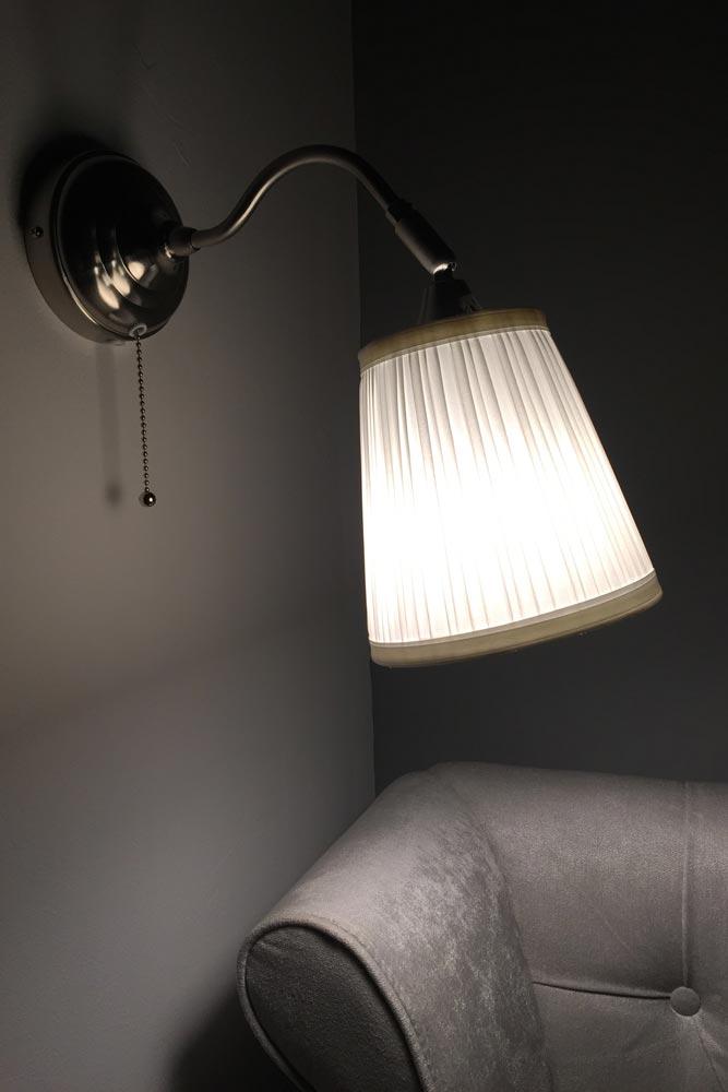 Master bedroom wall light at Chateau JAC