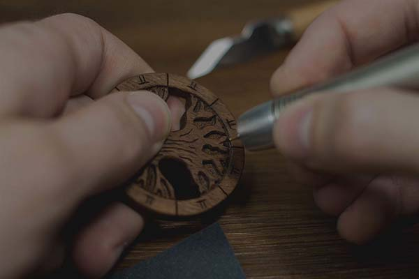 Each piece of wooden jewelry is hand carved. Modern and traditional tools are used in the carving process.