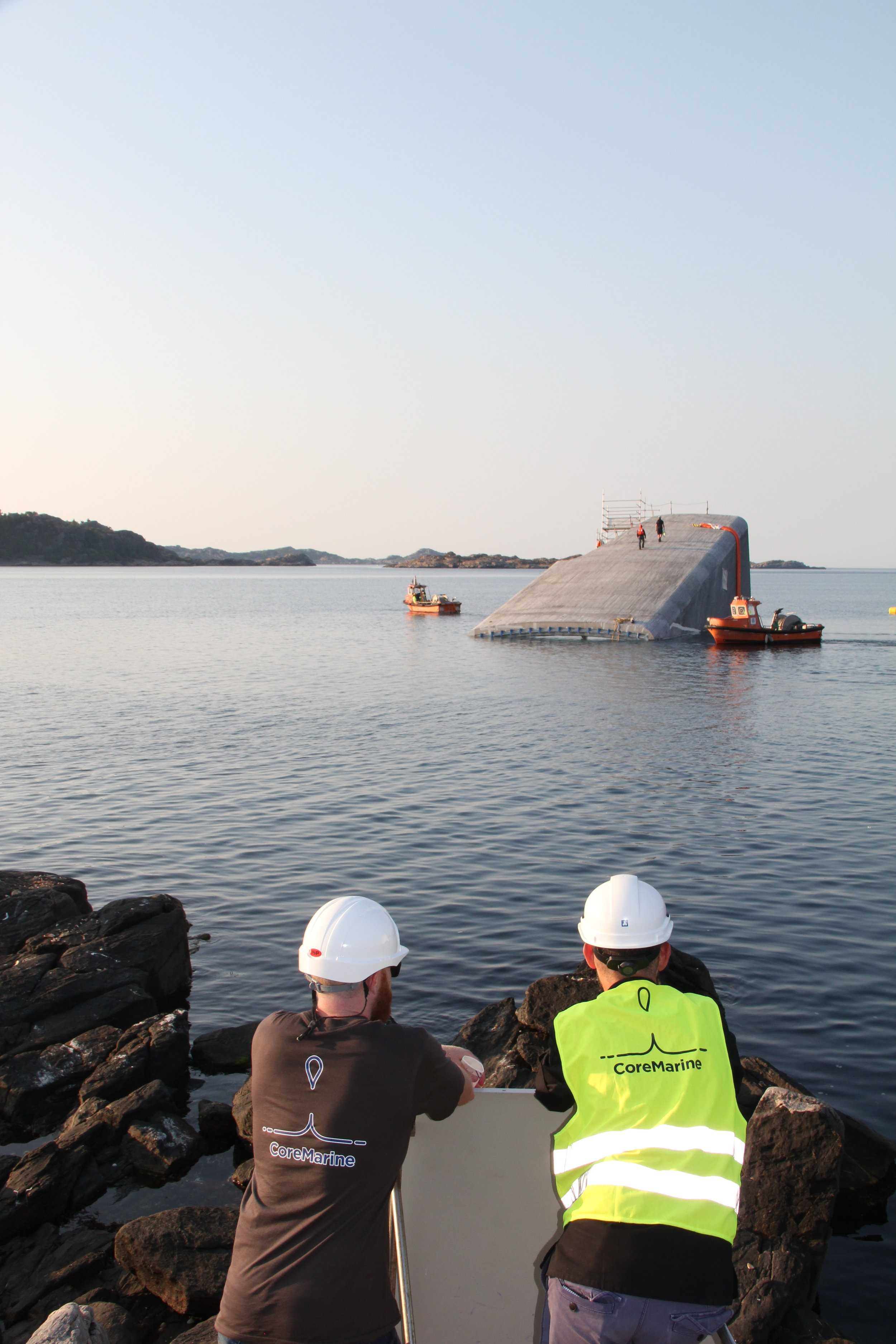 Ben Fitzgerald (Operations Director) and Sean Van Steel (Engineering Manager) observing the free floating Under structure at dawn