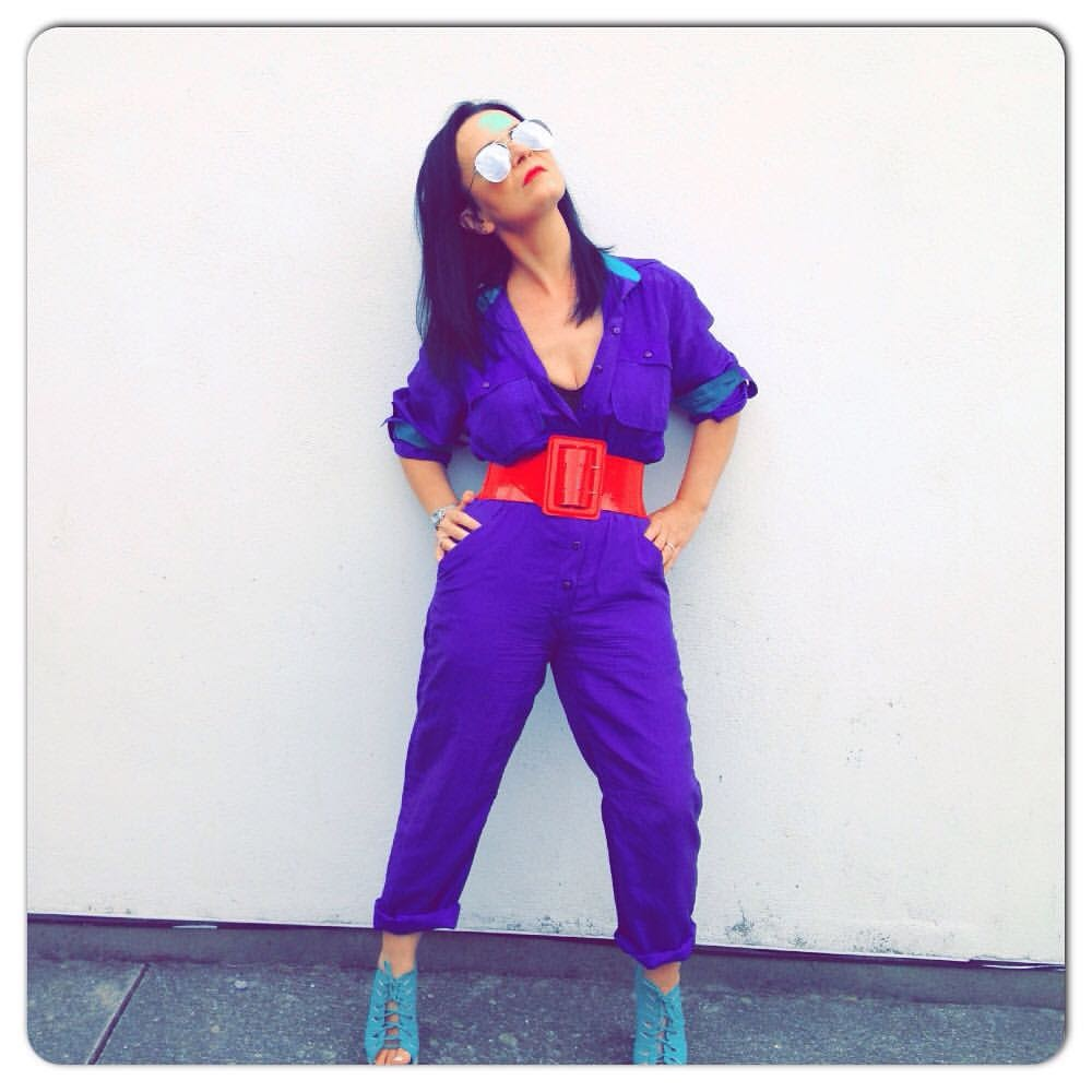 TBS. Throw back from the summer but a perfect example of colour fun. A purple vintage 80's jumpsuit ,red patent wasp belt and turquoise wedges complete with aviator shades give this look a vibrant original feel.
