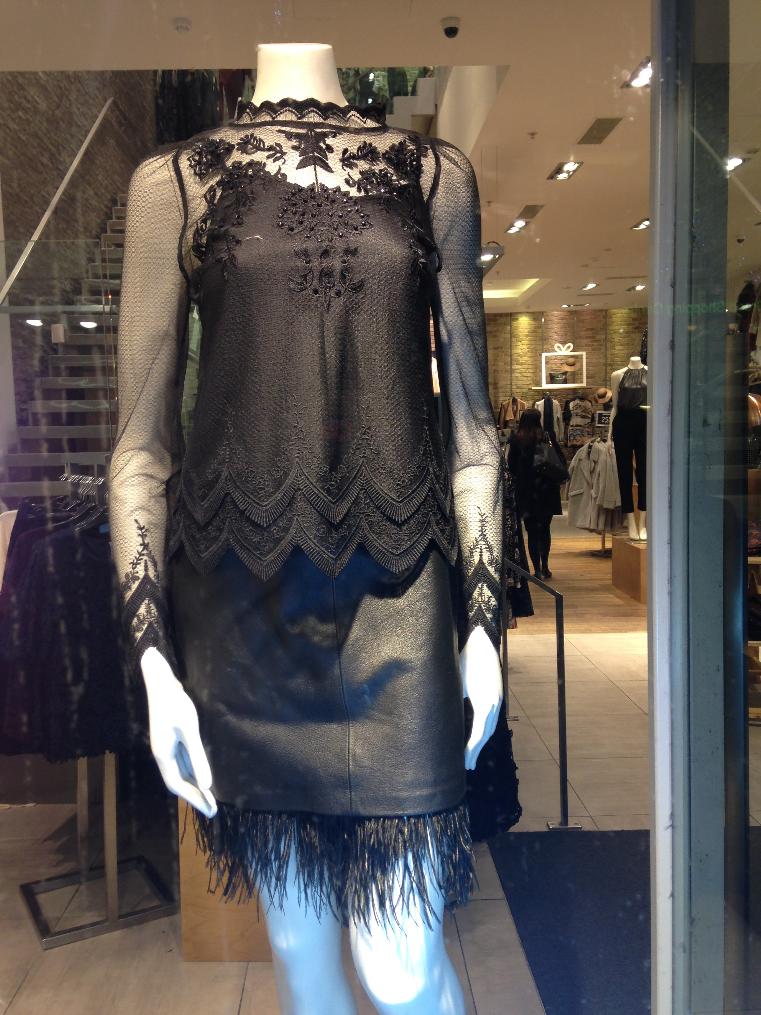 Warehouse! Fab black long sleeved lace top €72 worn with Black leather skirt with feather edging. I love this! €84