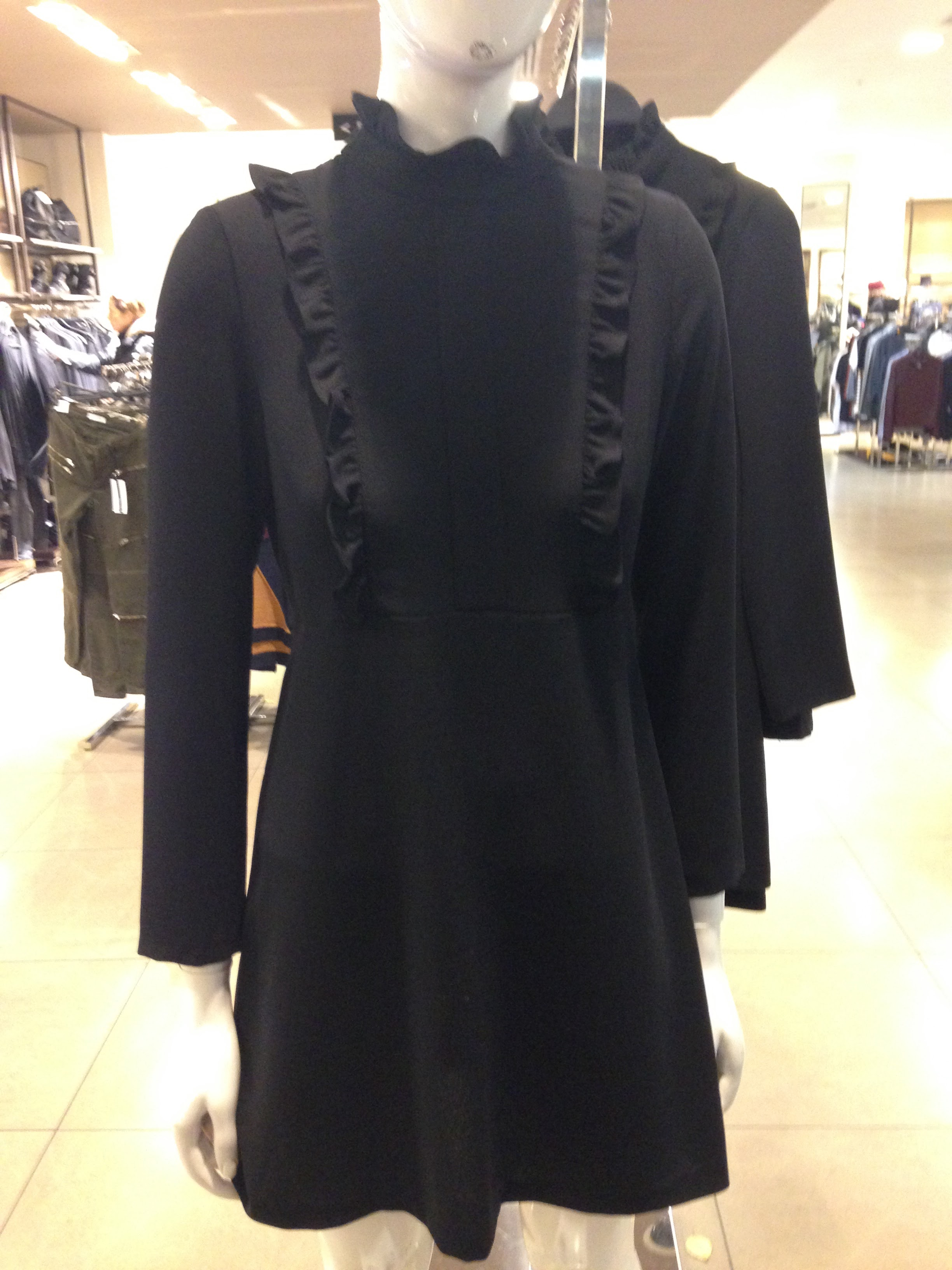 Zara! Great and versatile short black dress for a casual Goth or Glitz it up for evening. Love the fact its got long sleeves. €49.99 BEST BUY!
