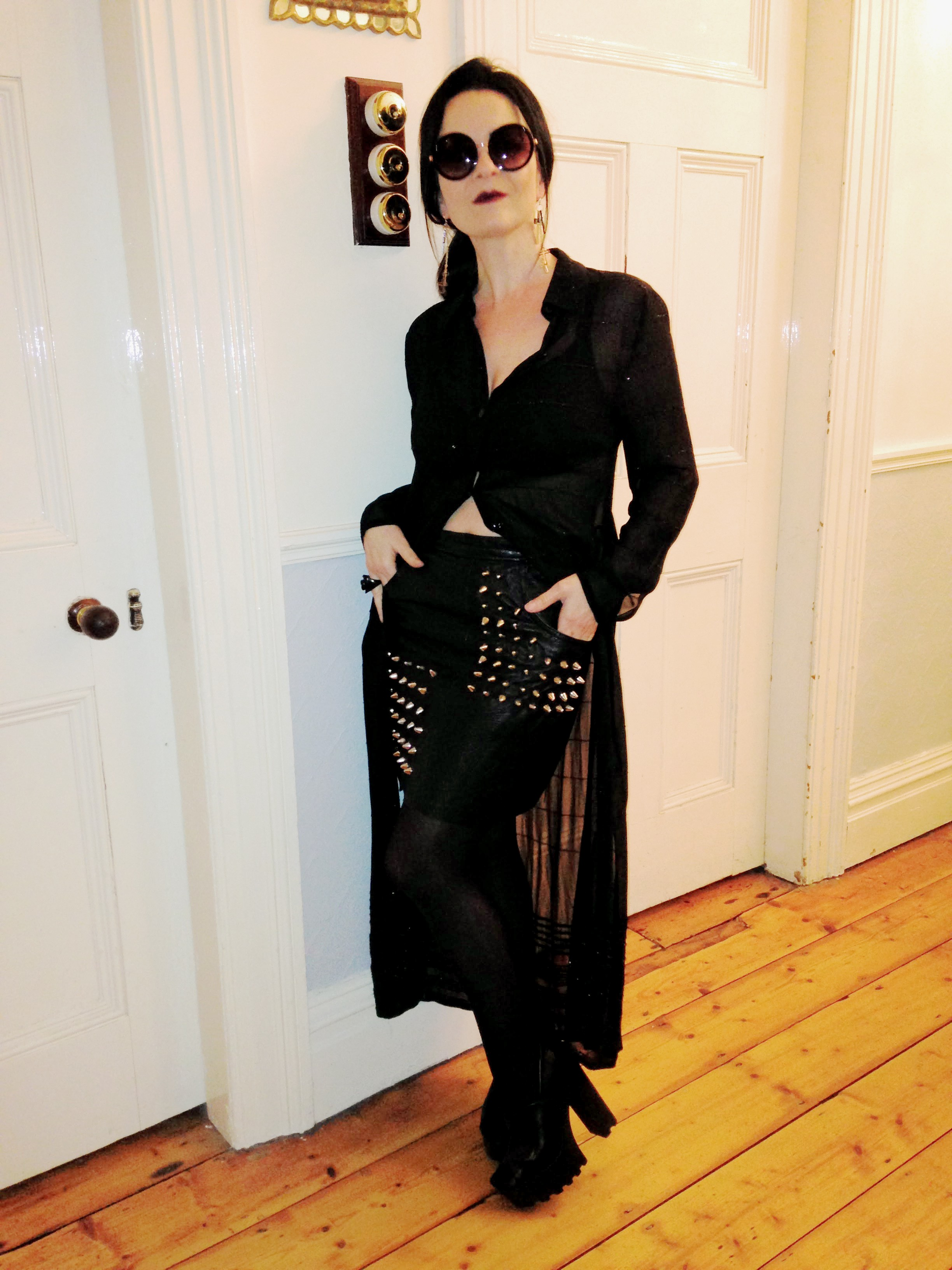 This look a re-worked black leather mini skirt with spike details. Tough Goth! Ha ha!