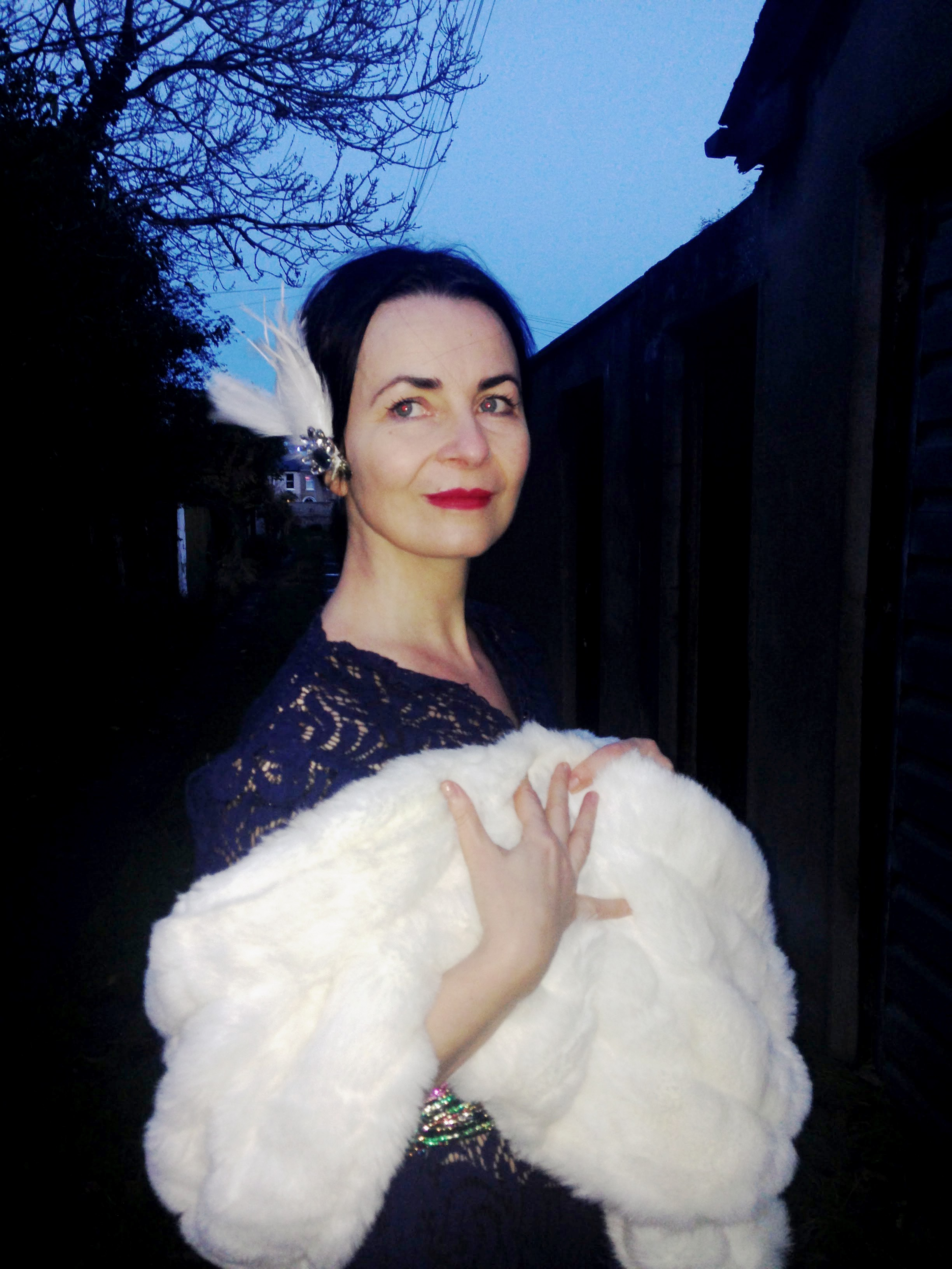 Magic Midnight Hour! Beautiful vintage lace 1930s dress paired with a winter white faux fur wrap and a quirky diamante and feather headpiece. Love this!