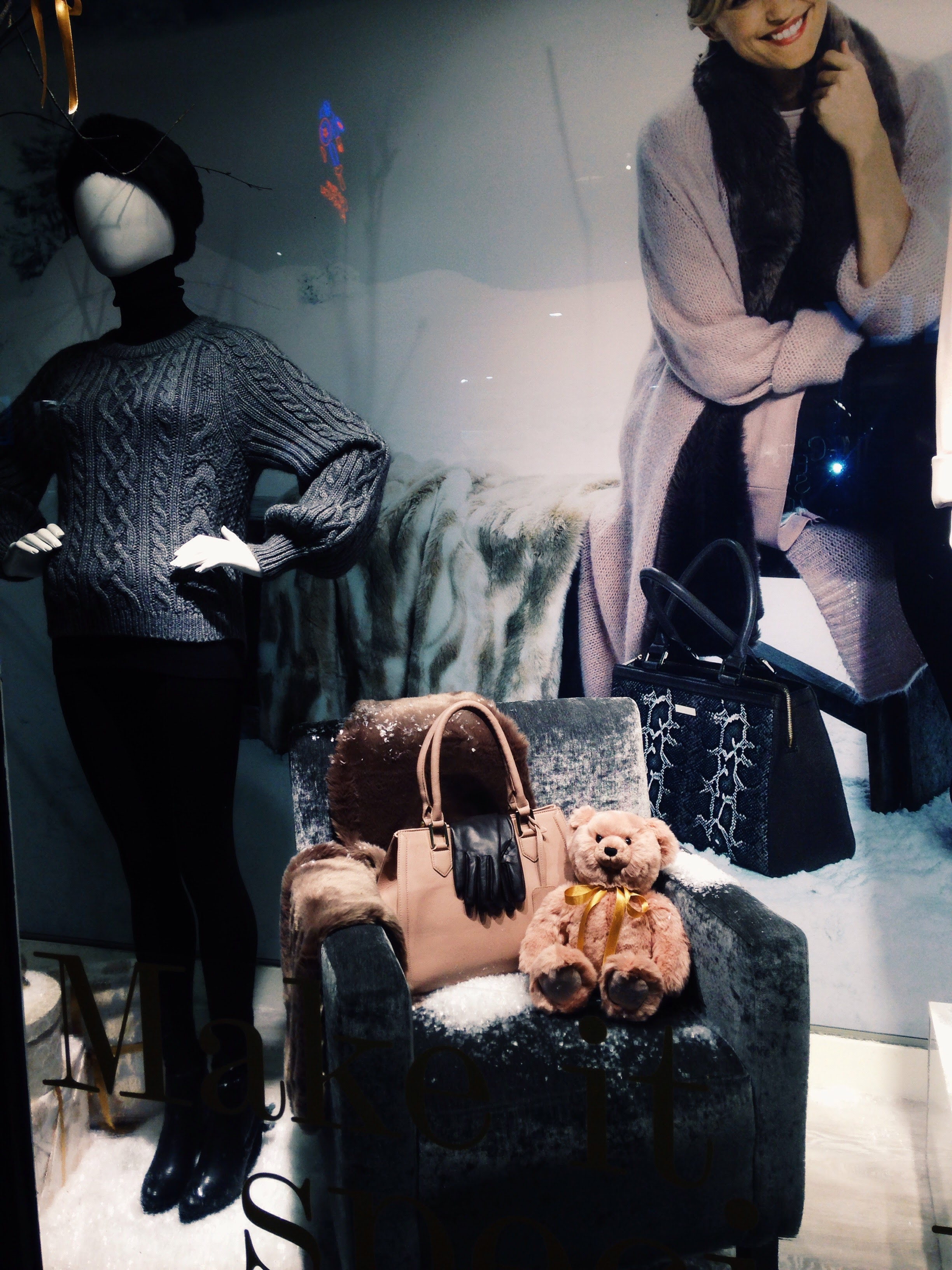 Dunnes Stores Grafton St, Dublin. Paul Costelloe Xmas Window. Pink leather bag on chair €150.00. Amazing Quality! Enjoy!
