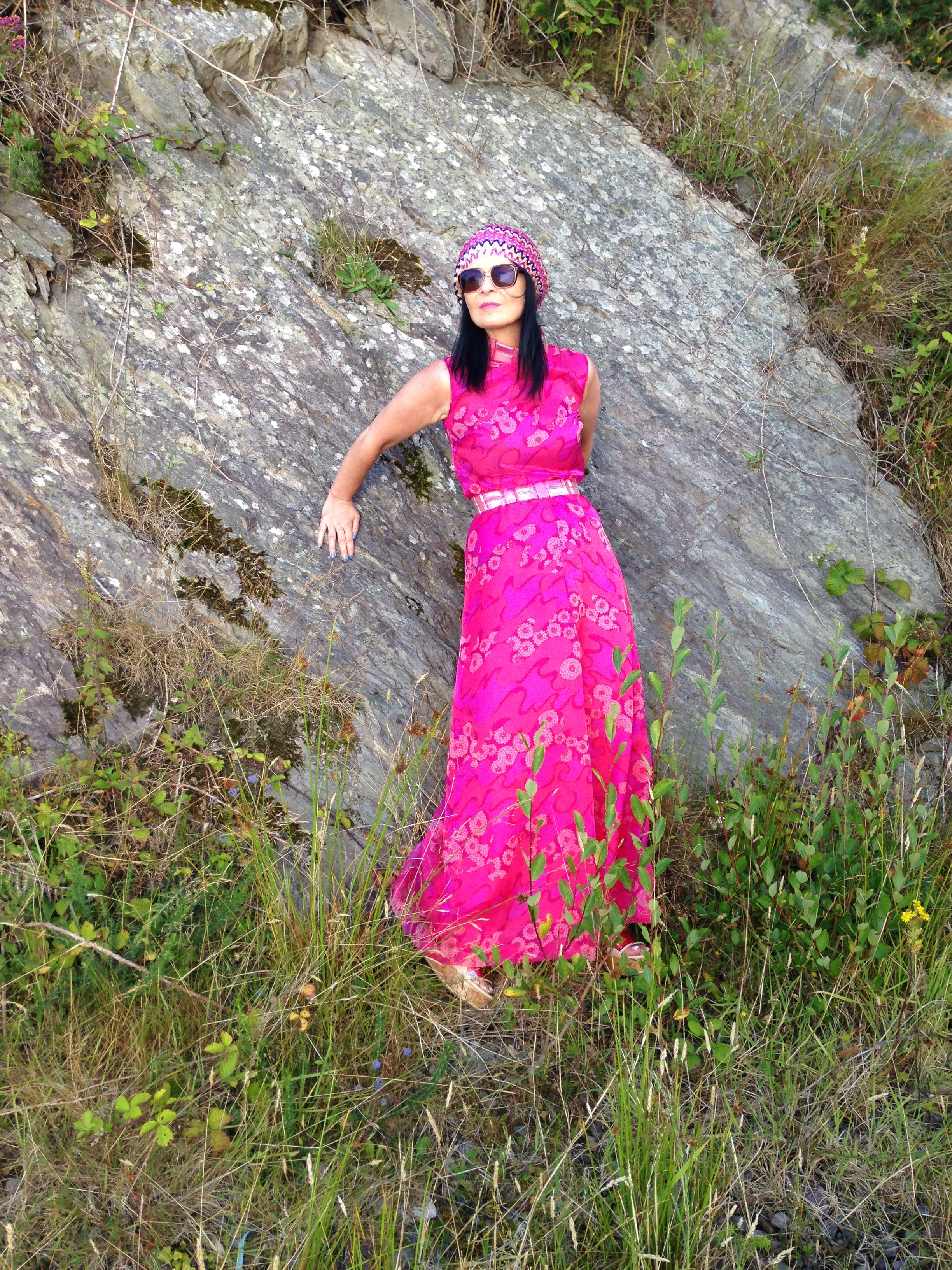 This photo taken in Augest 2015, proved popular because of the contrast between the rugged rock formations and the frivolous frothiness of the pink 60s catsuit.