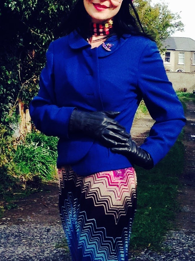 The addition of black vintage leather gloves give this an edgy appeal