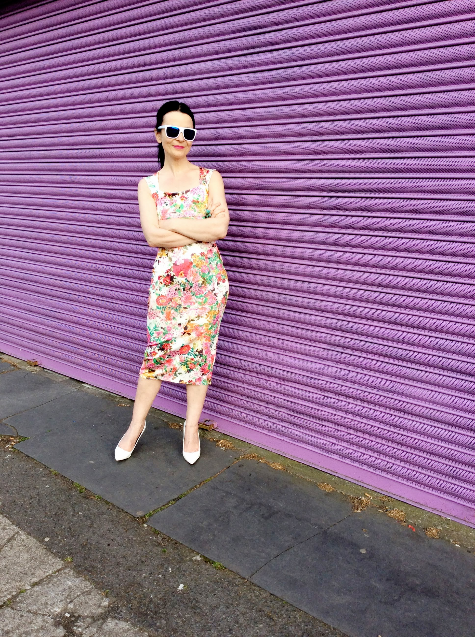 This floral Dress combined with white pumps gives a modern vibe!