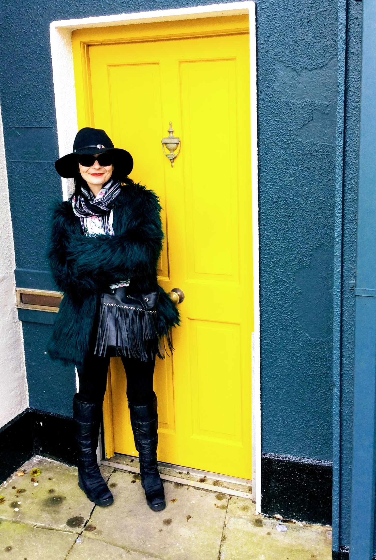 This high street faux fur coat look worn with a hat from Penneys/Primark