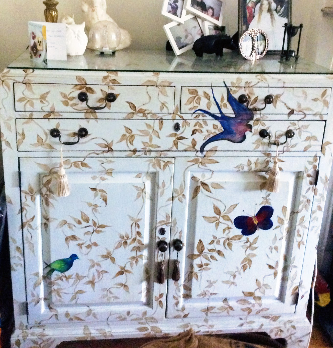 This was a huge oak 1980's TV cabinet. So I removed the top part and got some glass made for the top of remaining unit . Then I painted it and decorated it with a bird and butterfly design. This was bought at a car boot sale for €25!!!!!!!