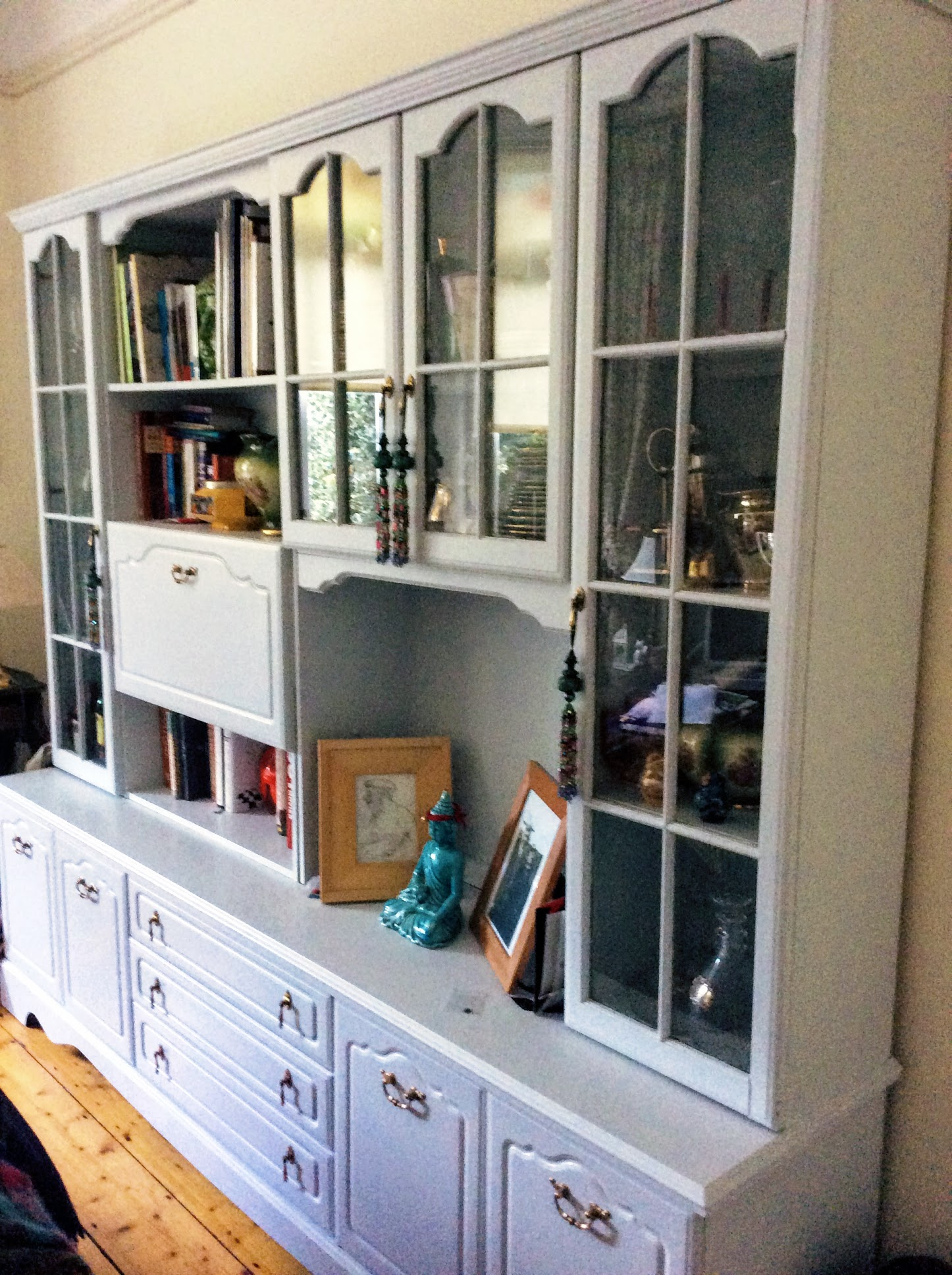 This was a drab and dreary 1980's very dark wood cabinet that I upcycled into a light airy and useful piece of furniture that doesn't eat up the room. It was bought in Bray for €40 in a furniture charity shop