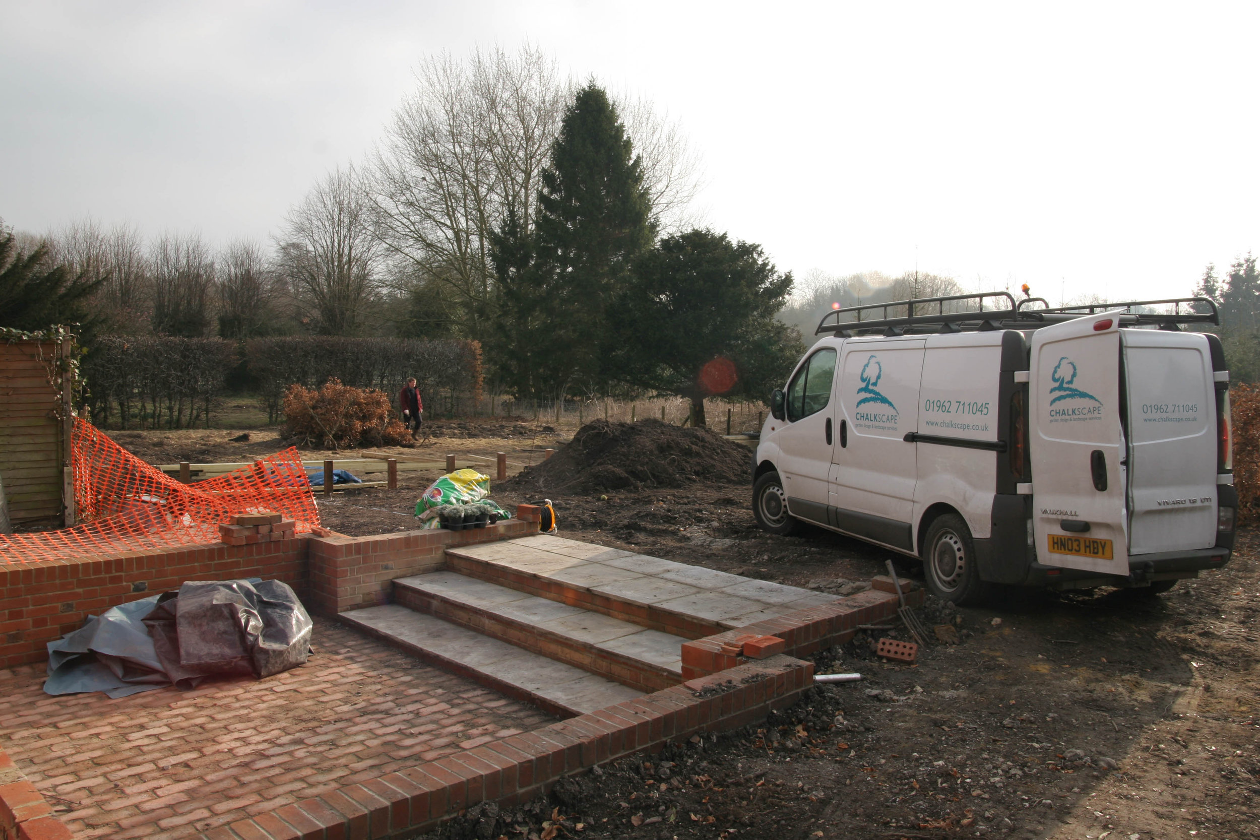 Finishing touches - working with other landscape firms the Chalkscape team start the soft landscaping of this newly created garden in Hampshire.