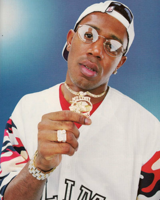 "Master P. holding his ""No Limits Records"" gold chain"