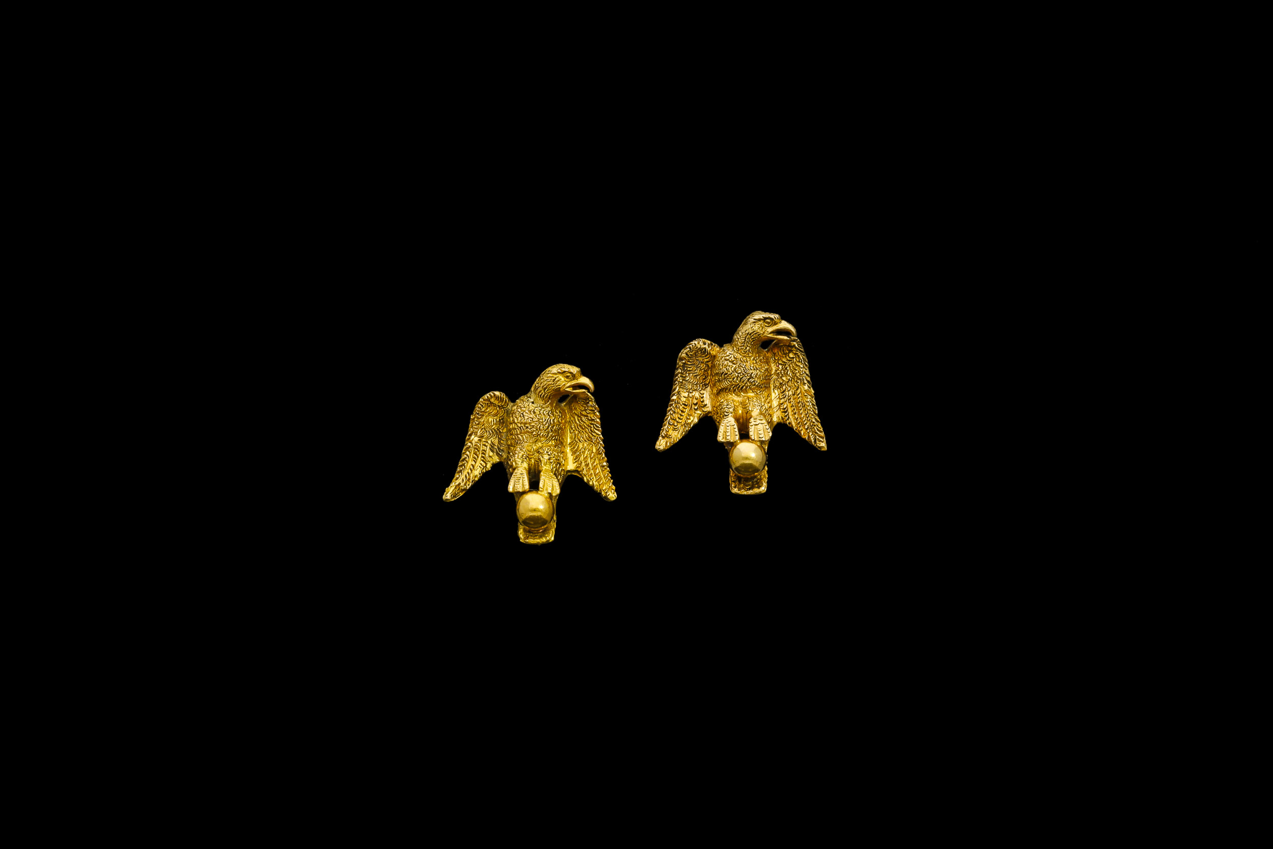 A pair of Victorian 15ct yellow gold hand tooled eagles perched on a ball earrings | £1260
