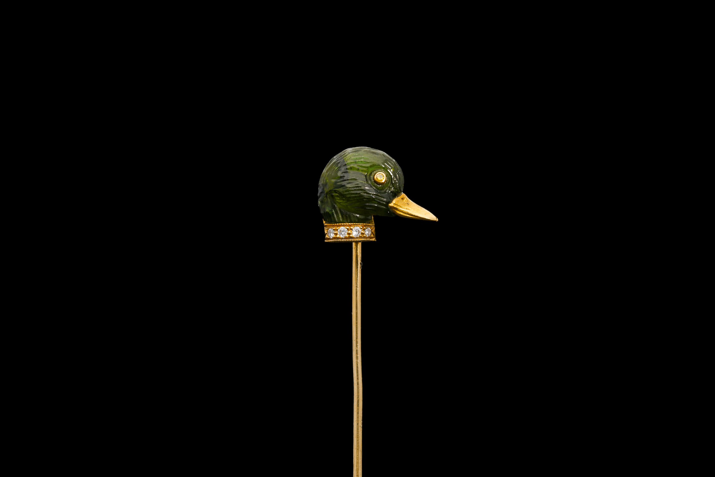 A green tourmaline duck stick pin | £1550