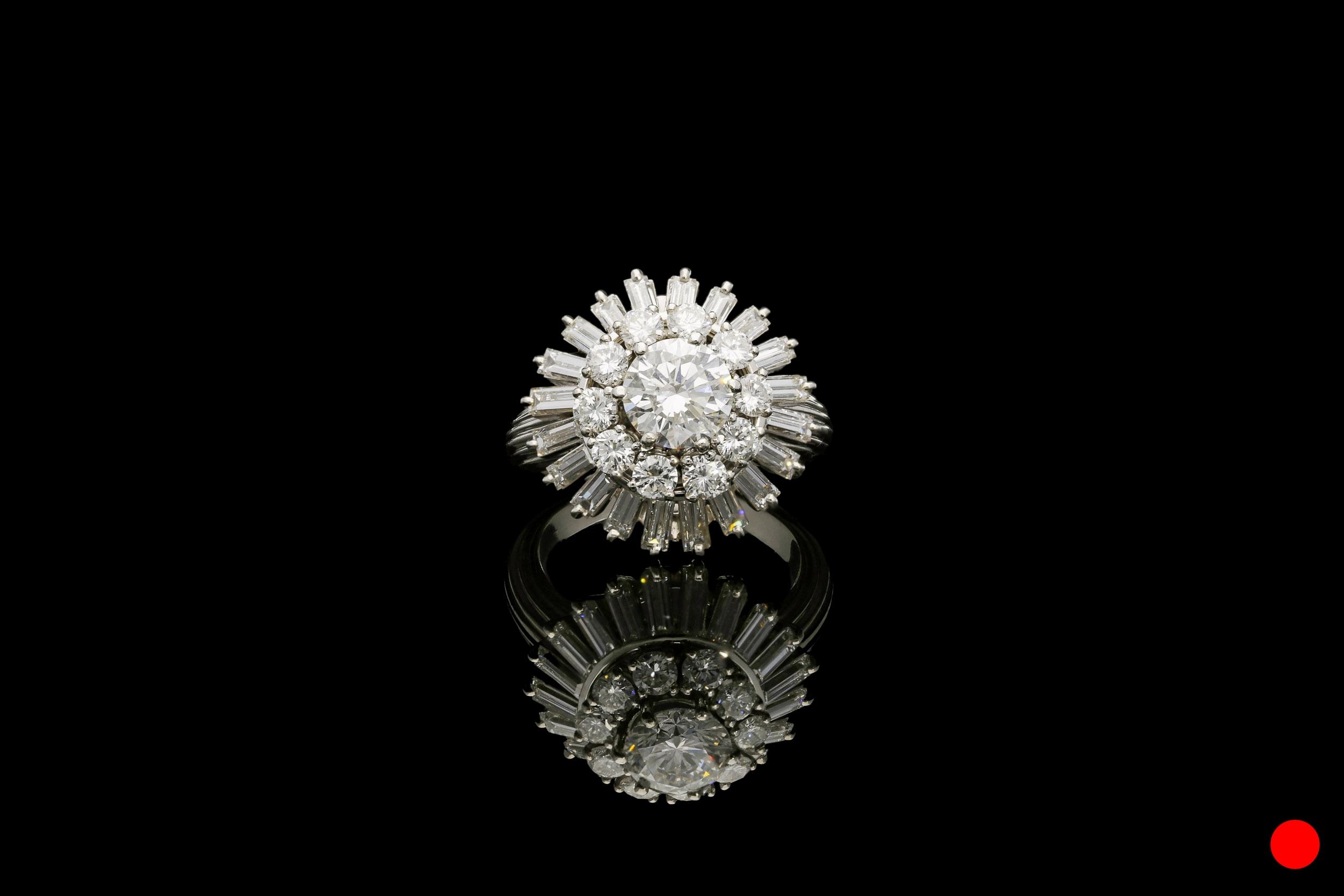 A 1950's platinum ballerina ring   £19950