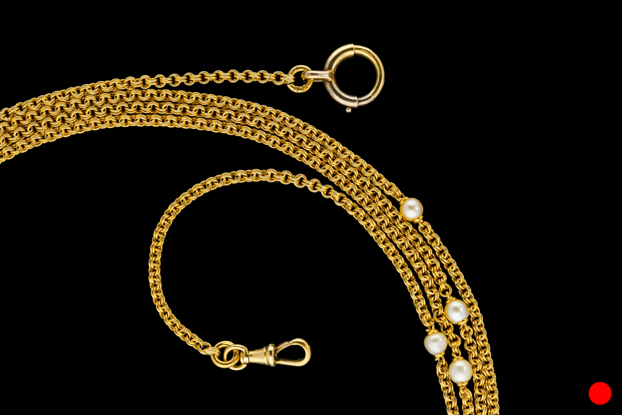 A French 18ct yellow gold round link guard chain set with pearls | £3100