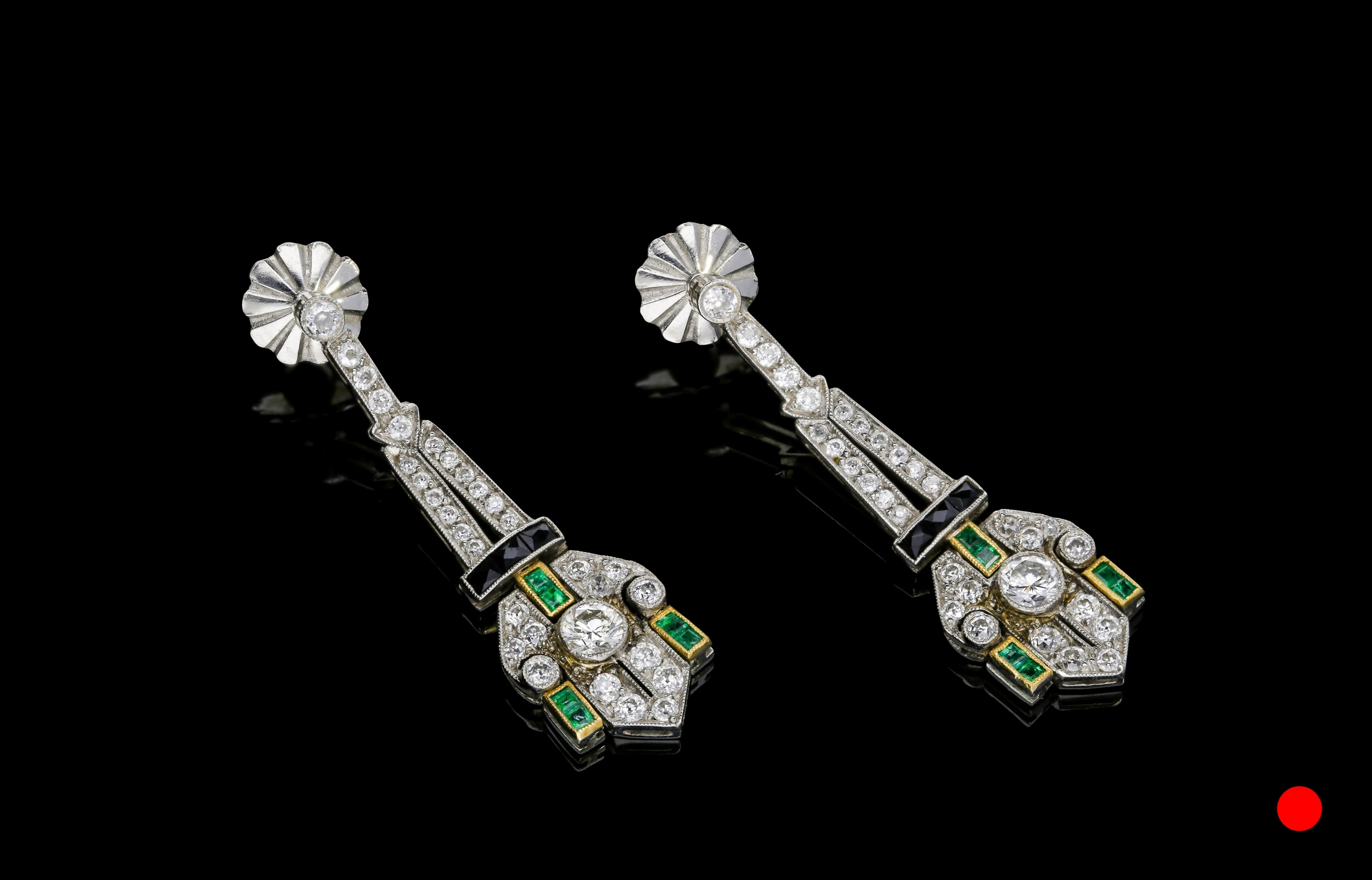 An exquisite pair of Art Deco emerald, onyx and diamond drop earrings set | £14500