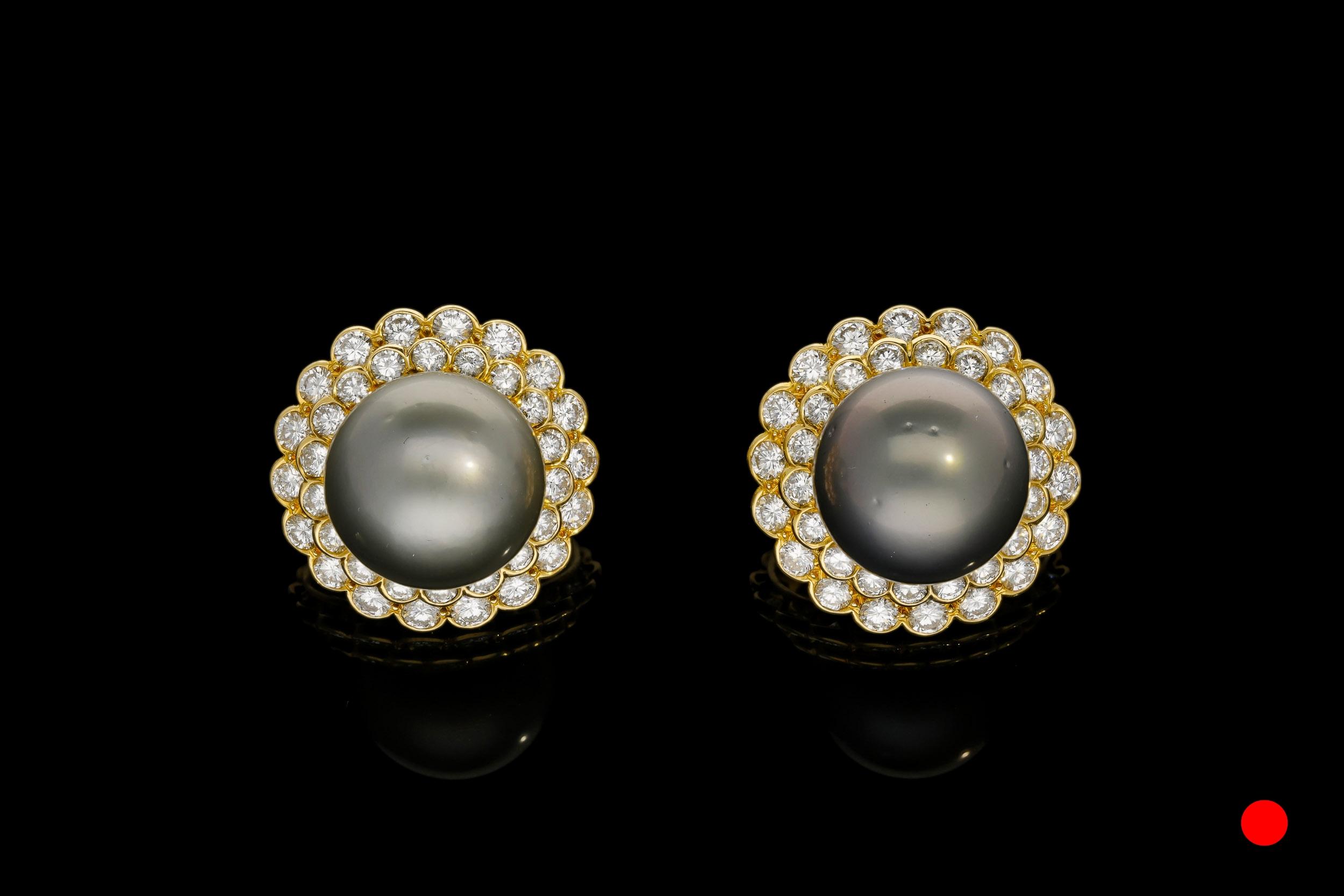 A magnificent pair of 1970's Boucheron Paris Tahitian pearl and diamond earrings set | £14850