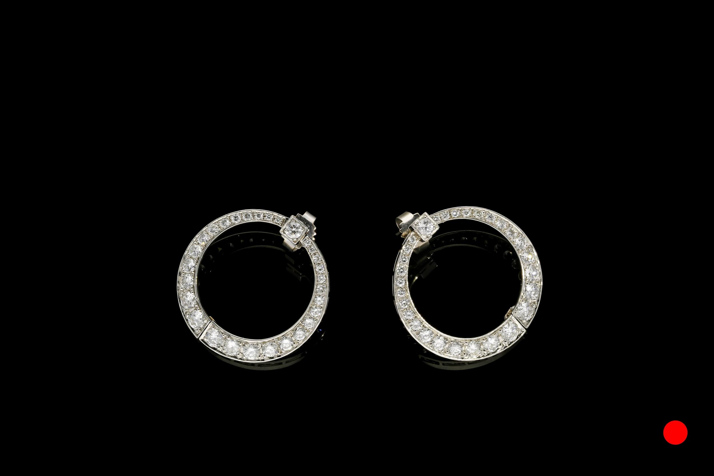 An ingenious pair of Art Deco platinum and diamond hinged wrap around hoop earrings | £7450