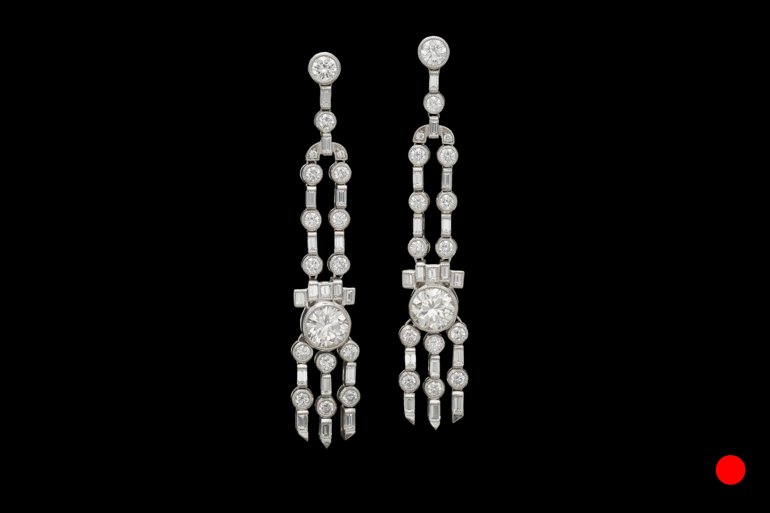 A stunning pair of iconic Art Deco platinum and diamond chandelier drop earrings | £19850
