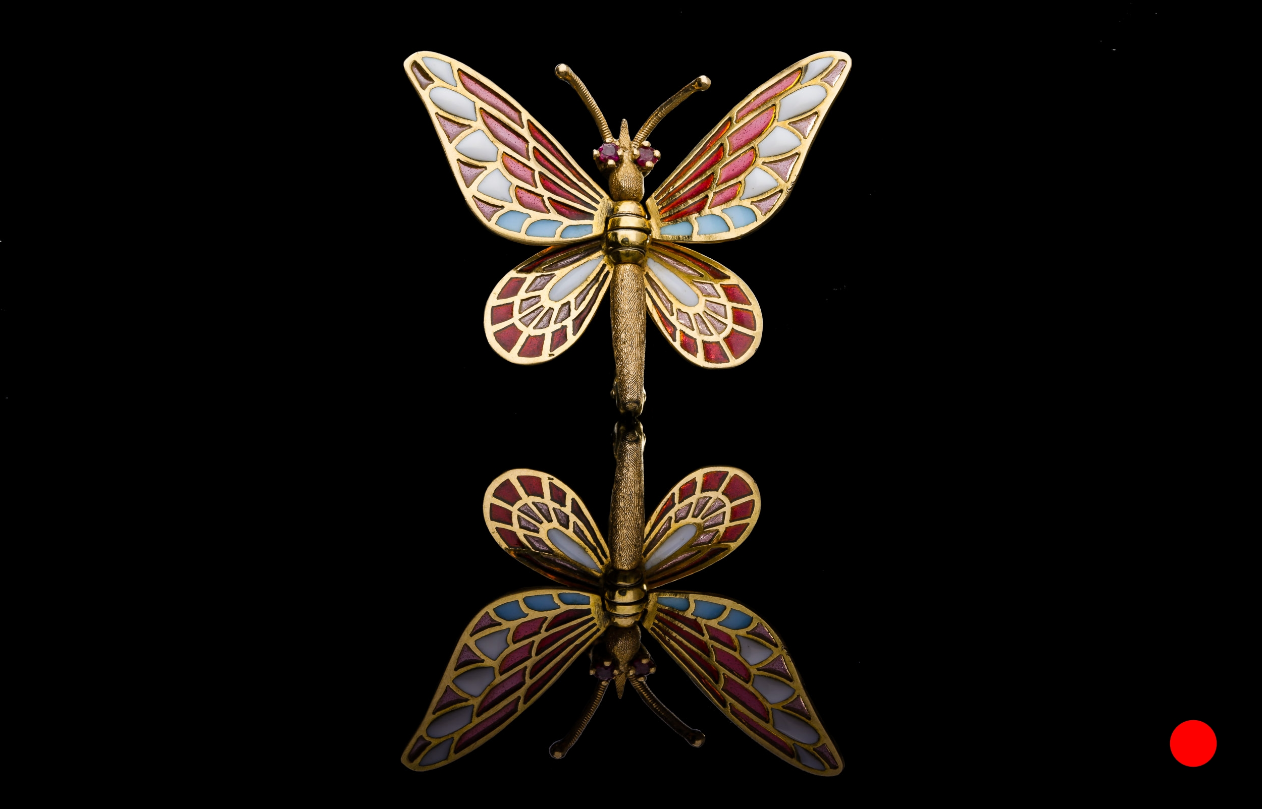 A 1950's plique-a-jour butterfly brooch | £2450