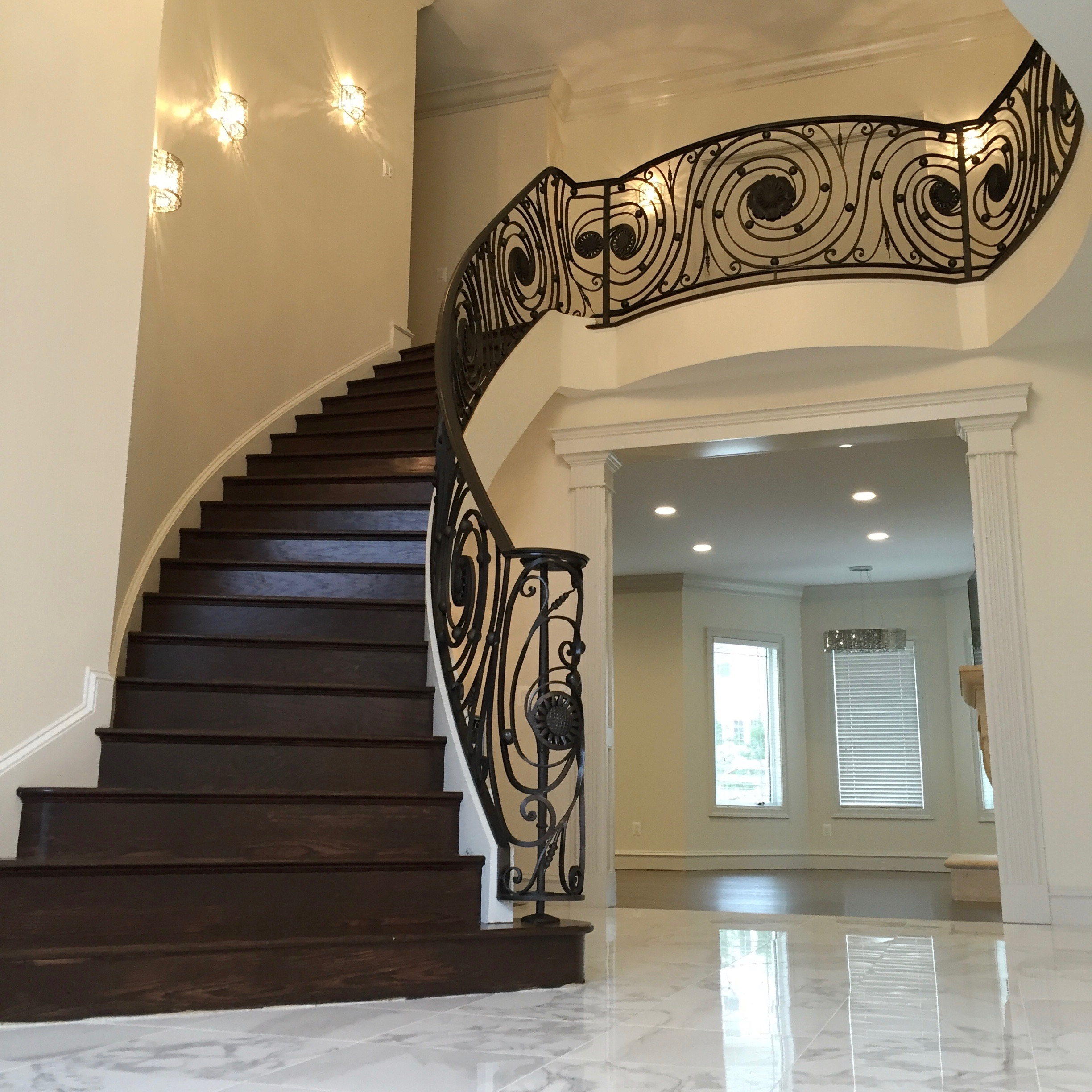 Ornate railing hugs this beautiful staircase