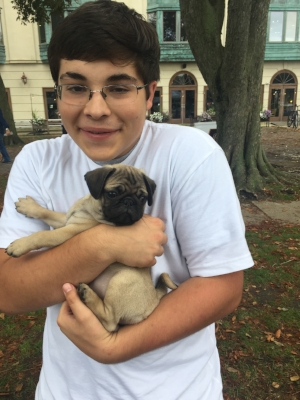This photo of Nicholas was taken in September 2017. We had just finished at the Asbury Fresh market and someone came with a little pug puppy and let us hold him.