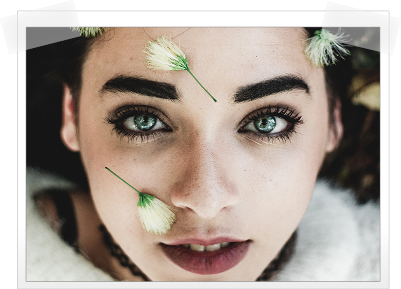 girl-flowers-on-face-bright-eyes.png