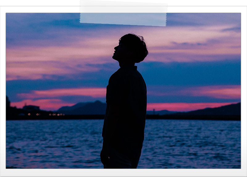 man-silhouette-looking-up-sunset.png