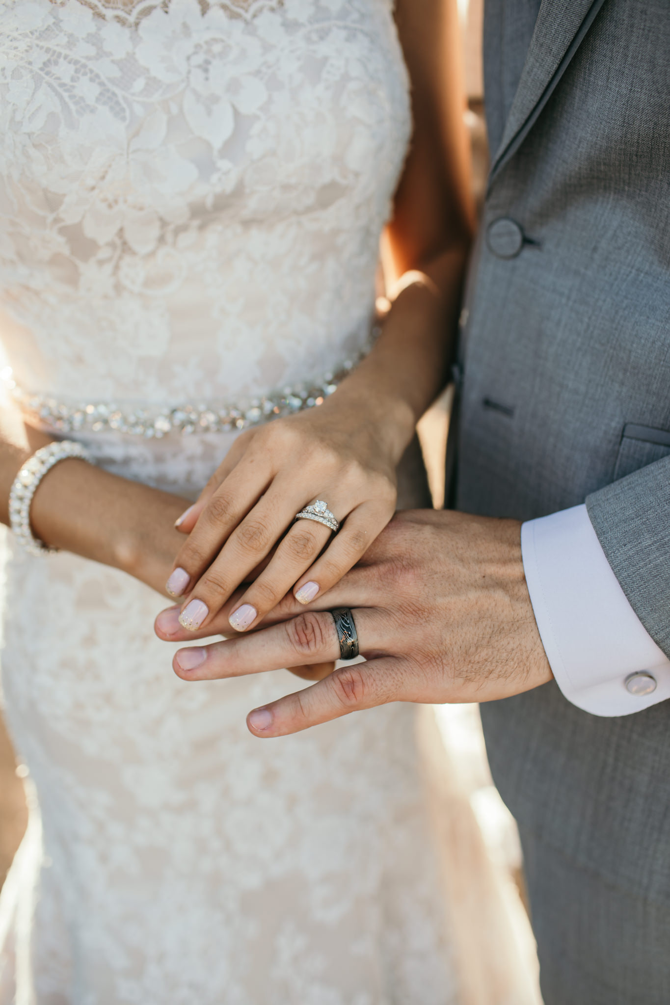 Husband and Wife Hands Wedding Bands