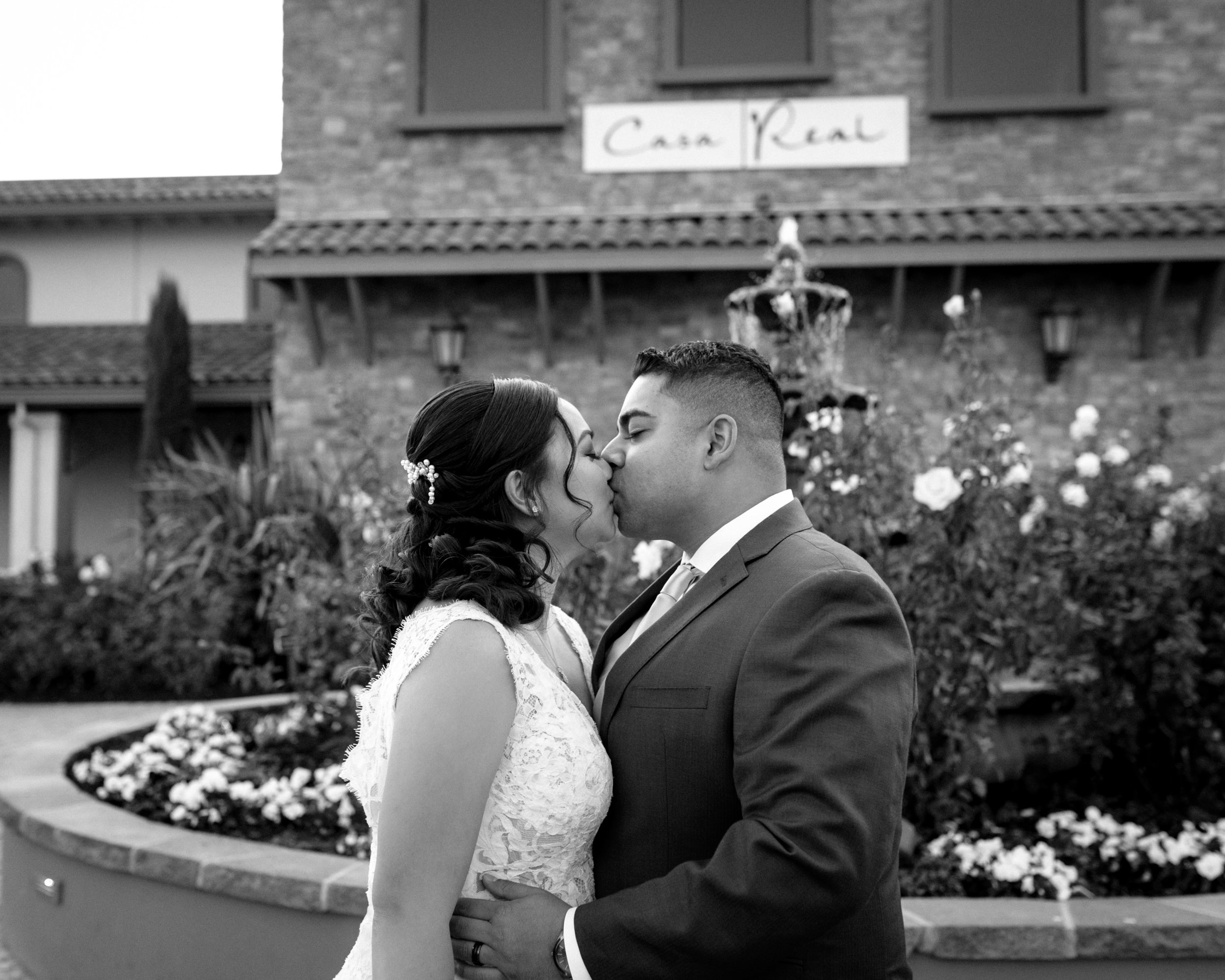 Bride and Groom Kiss Outside Casa Real Ruby Hill