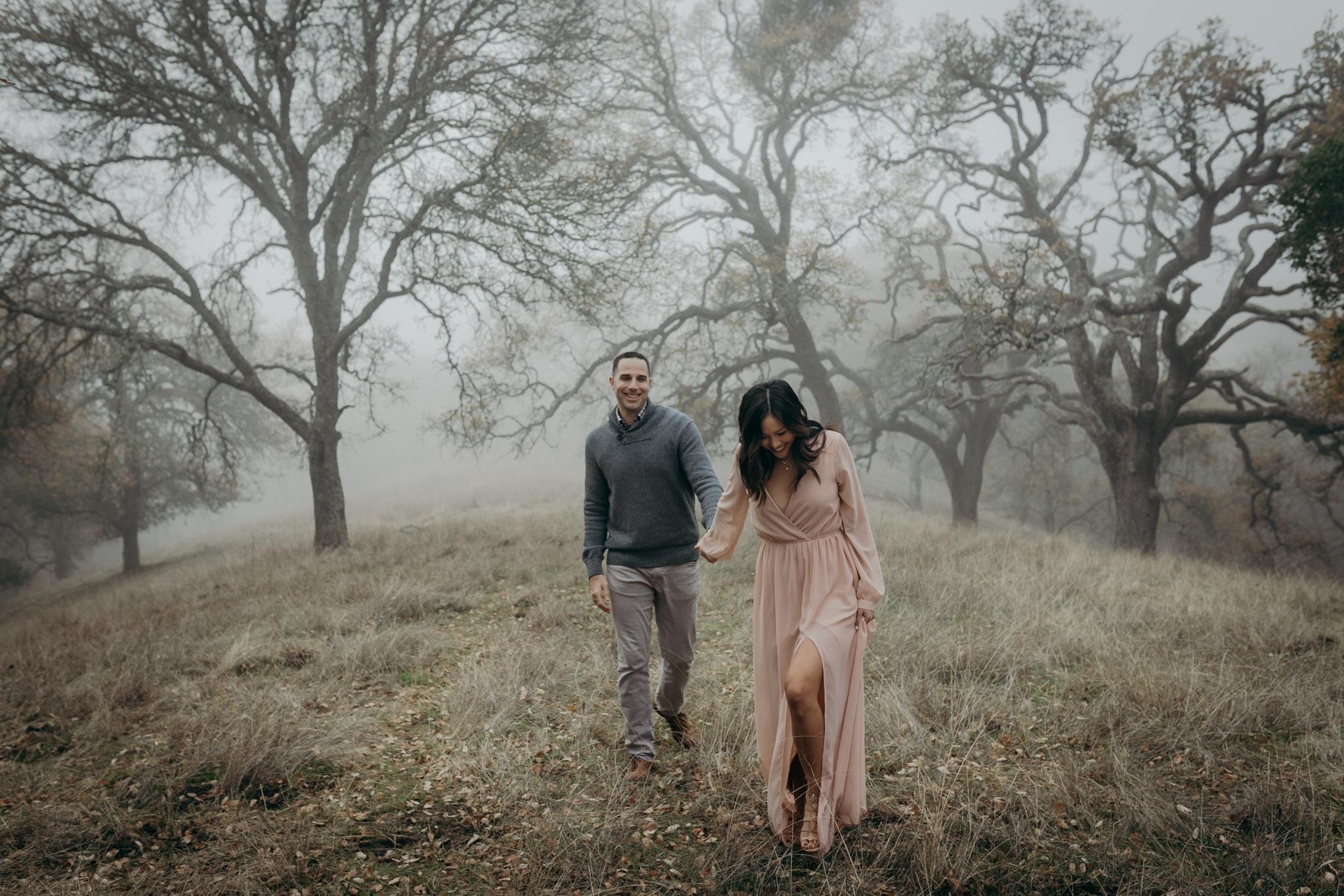 Walnut Creek Engagement Session Couple walking through fog