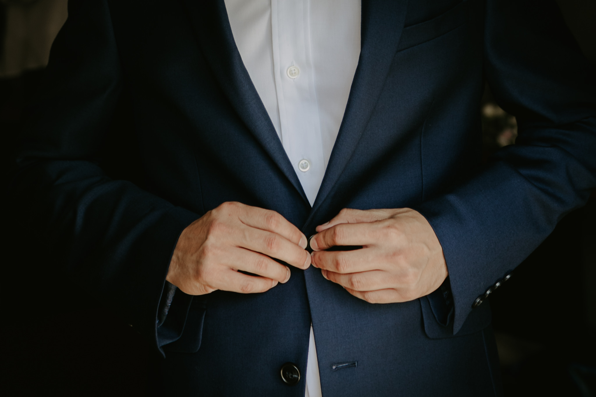 groom getting dressed wedding day
